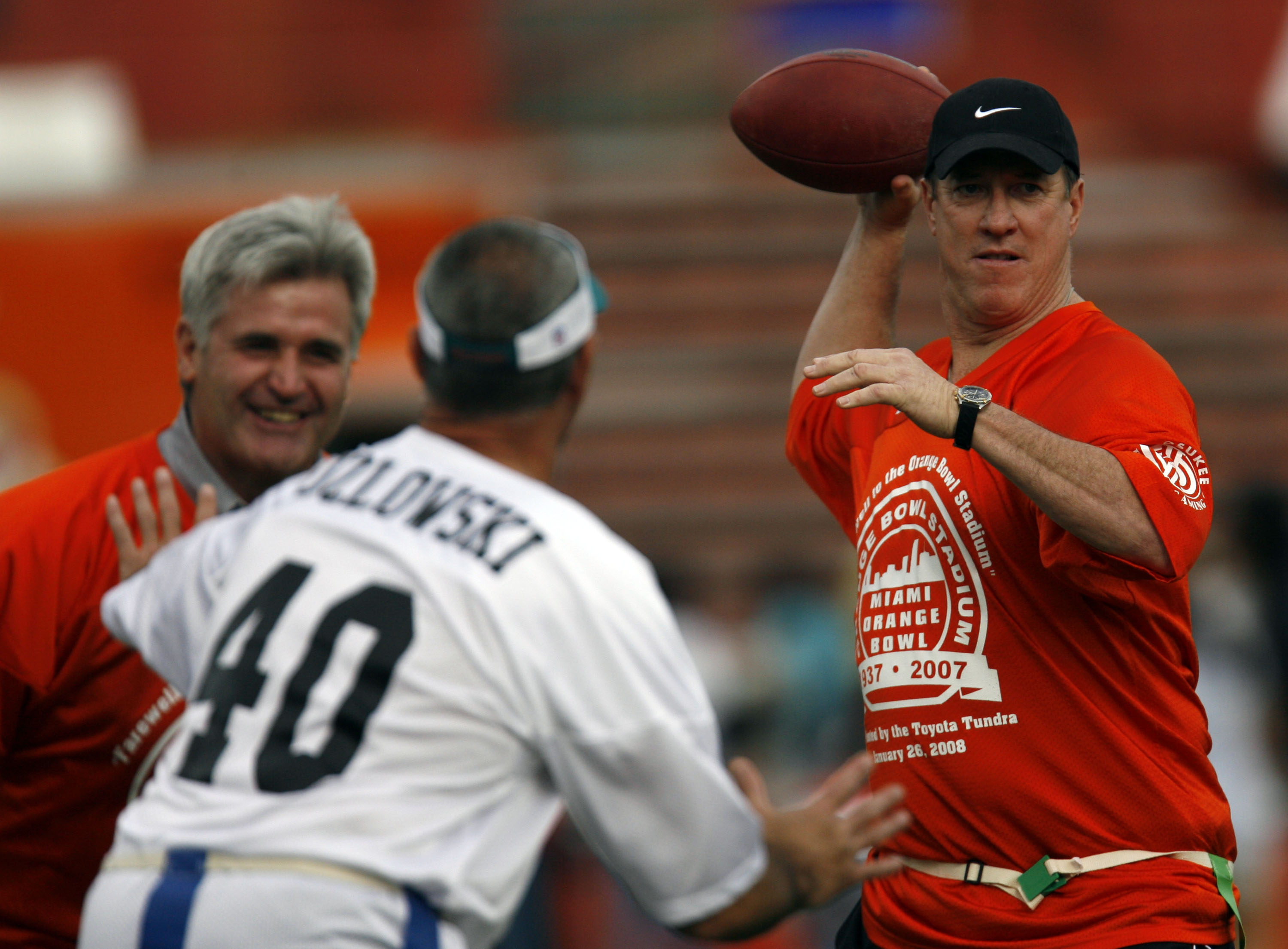 MIAMI, FL - JANUARY 26: Former University of Miami Hurricanes Quarterback Jim Kelly throws a pass during the final game at the Orange Bowl against the Miami Dolphins January 26, 2008 in Miami, Florida. This is the last game to be played in the Orange Bowl
