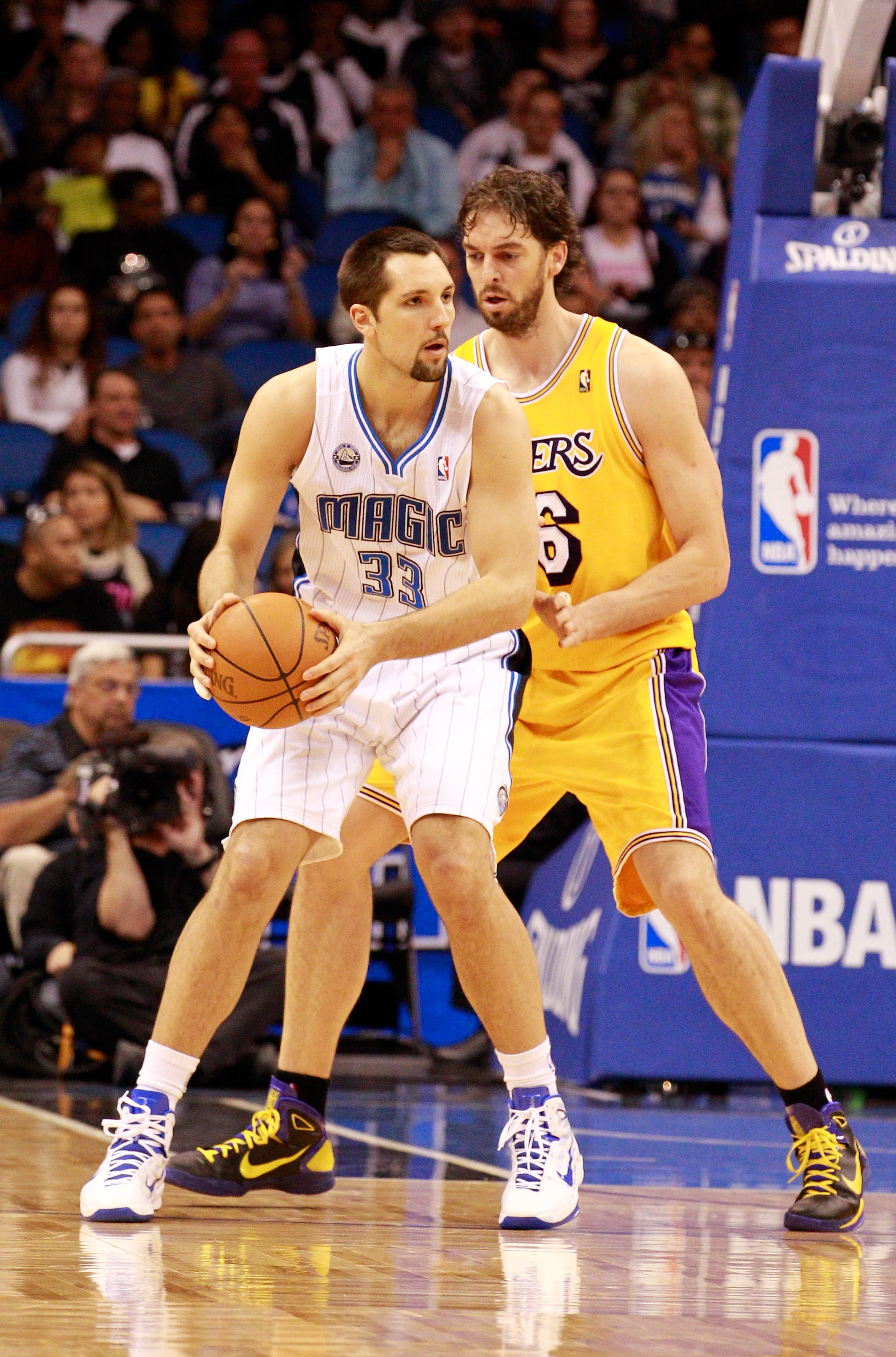 ORLANDO, FL - FEBRUARY 13:  Ryan Anderson #33 of the Orlando Magic is guarded by Pau Gasol #6 of the Los Angeles Lakers during the game at Amway Arena on February 13, 2011 in Orlando, Florida.  NOTE TO USER: User expressly acknowledges and agrees that, by