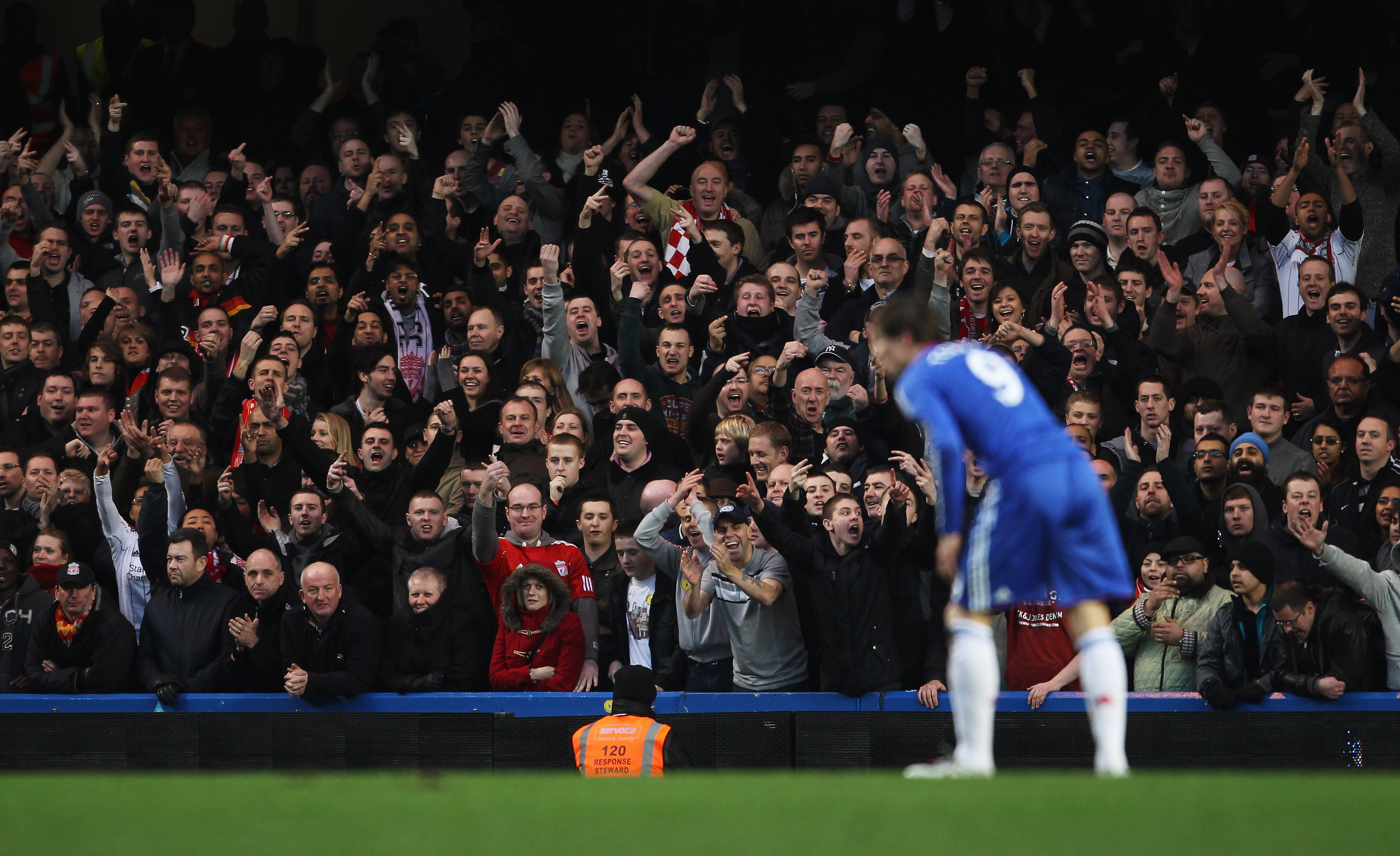 LONDON, ENGLAND - FEBRUARY 06:  Liverpool fans gestures towards Fernando Torres of Chelsea during the Barclays Premier League match between Chelsea and Liverpool at Stamford Bridge on February 6, 2011 in London, England.  (Photo by Scott Heavey/Getty Imag