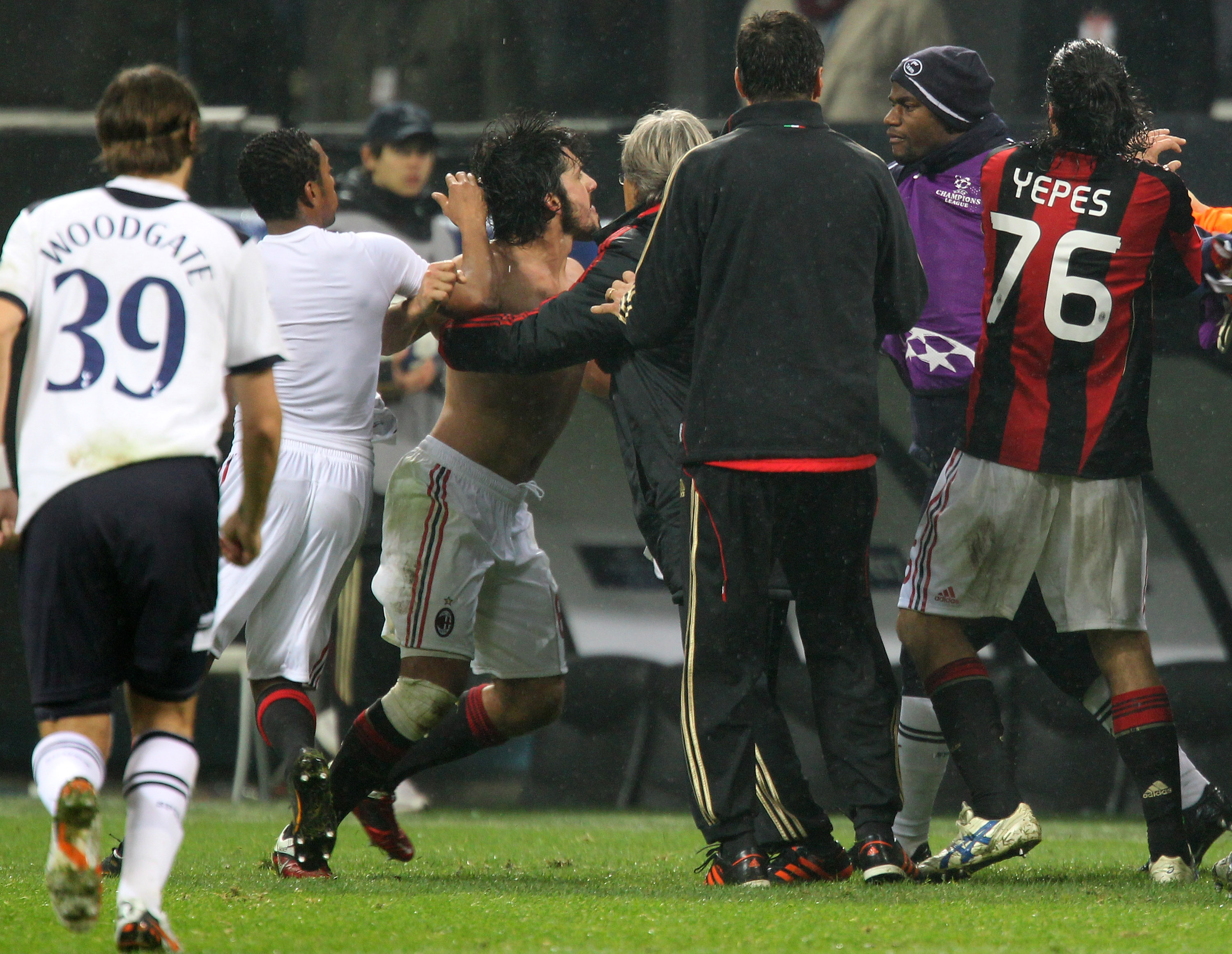 MILAN, ITALY - FEBRUARY 15:  Gennaro Gattuso of AC Milan is restrained at the end of the UEFA Champions League round of 16 first leg match between AC Milan and Tottenham Hotspur at Stadio Giuseppe Meazza on February 15, 2011 in Milan, Italy.  (Photo by Al