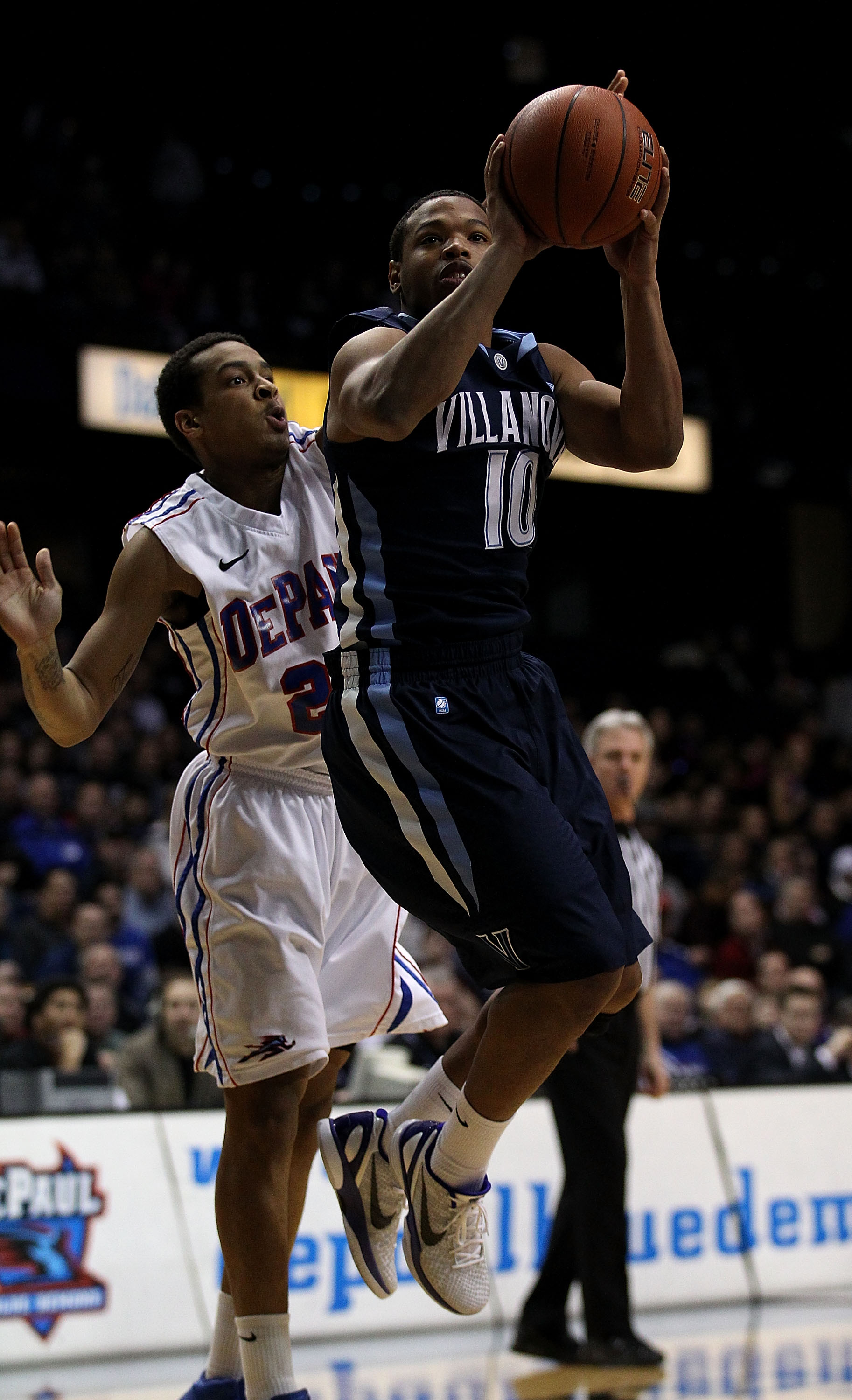 ROSEMONT, IL - FEBRUARY 19: Corey Fisher #10 of the Villanova Wildcats shoots under pressure from Brandon Young #20 of the DePaul Blue Demons at the Allstate Arena on February 19, 2011 in Rosemont, Illinois. (Photo by Jonathan Daniel/Getty Images)