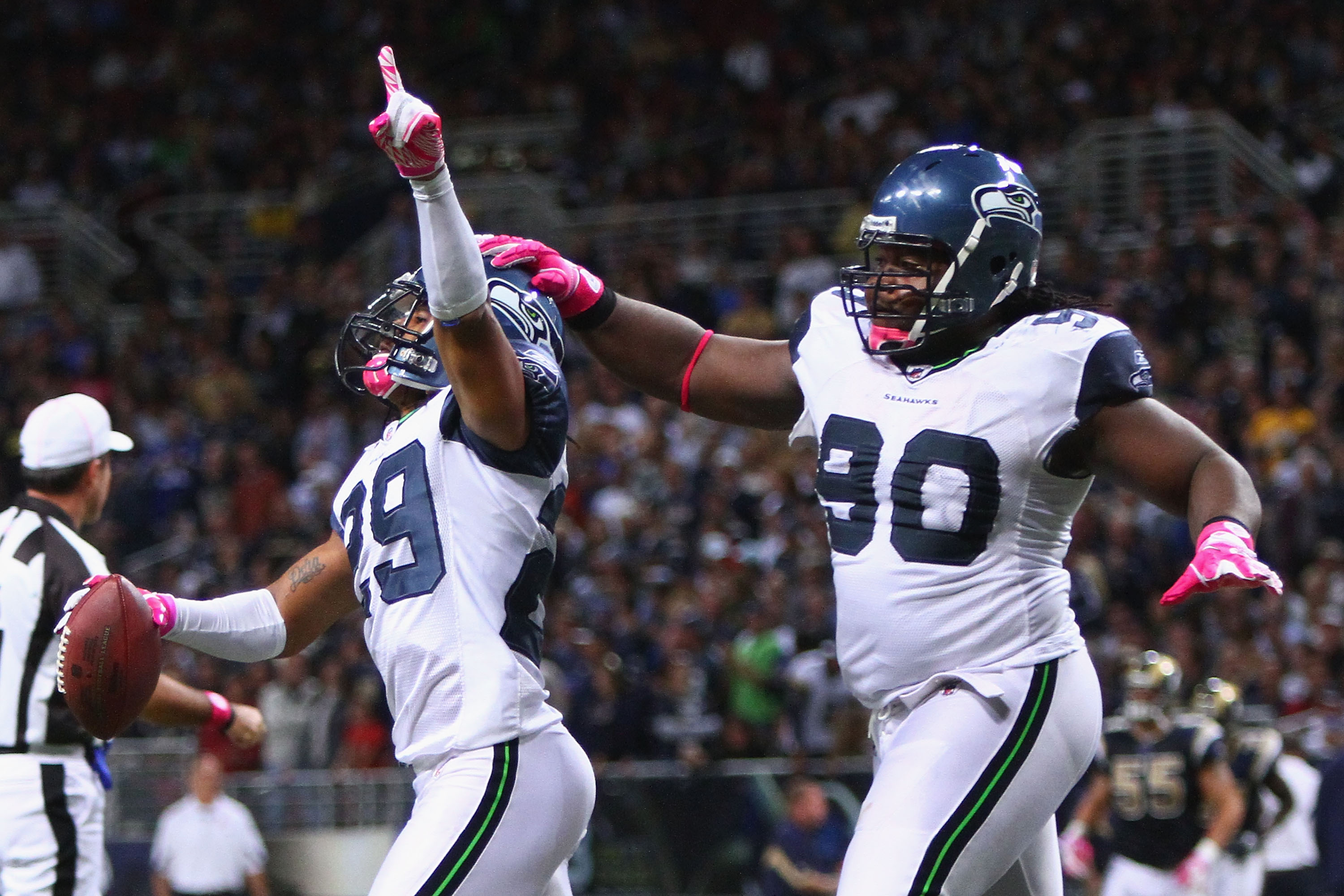 Earl Thomas (#29) celebrating with Colin Cole (#90)