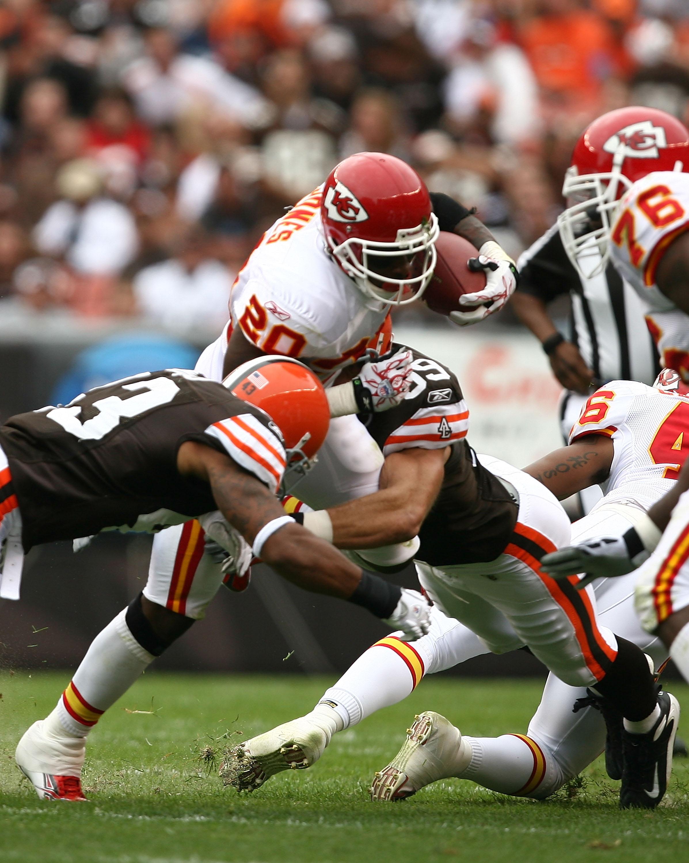 T.J. Ward (43) attempting to tackle Thomas Jones (20)
