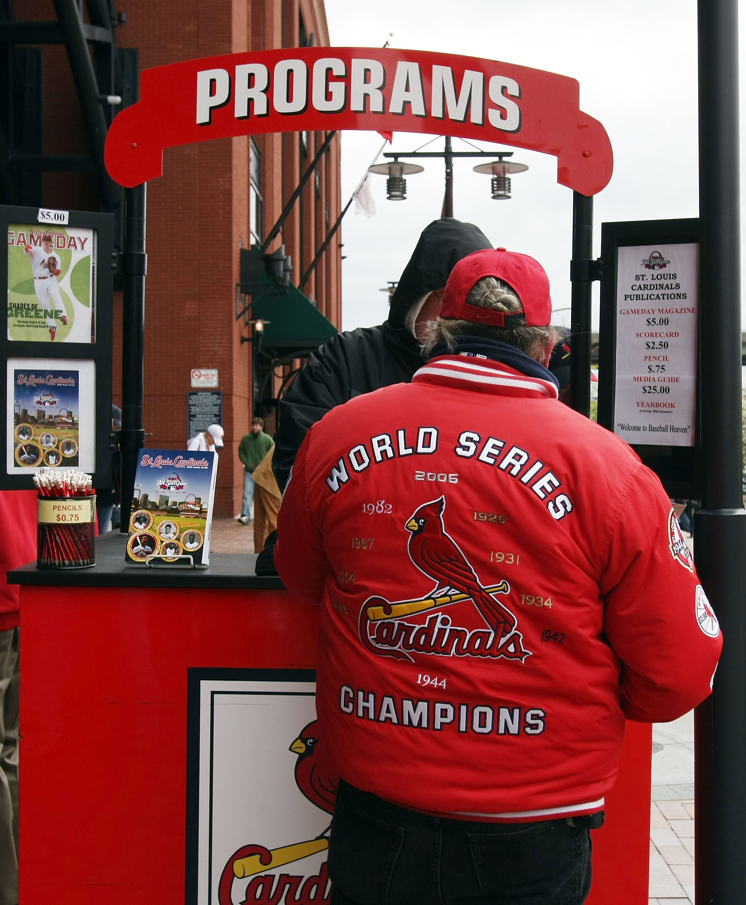 ST. LOUIS - APRIL 06:  Fans buy programs before the game between the St. Louis Cardinals and the Pittsburgh Pirates during Opening Day on April 6, 2009  at Busch Stadium in St. Louis, Missouri.  (Photo by Elsa/Getty Images)
