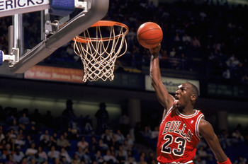 1990 -1991: Michael Jordan #23 of the Chicago Bulls goes up for a dunk during an NBA game against the Dallas Mavericks at Reunion Arena in Dallas, Texas. (Photo by Joe Patronite/Getty Images)