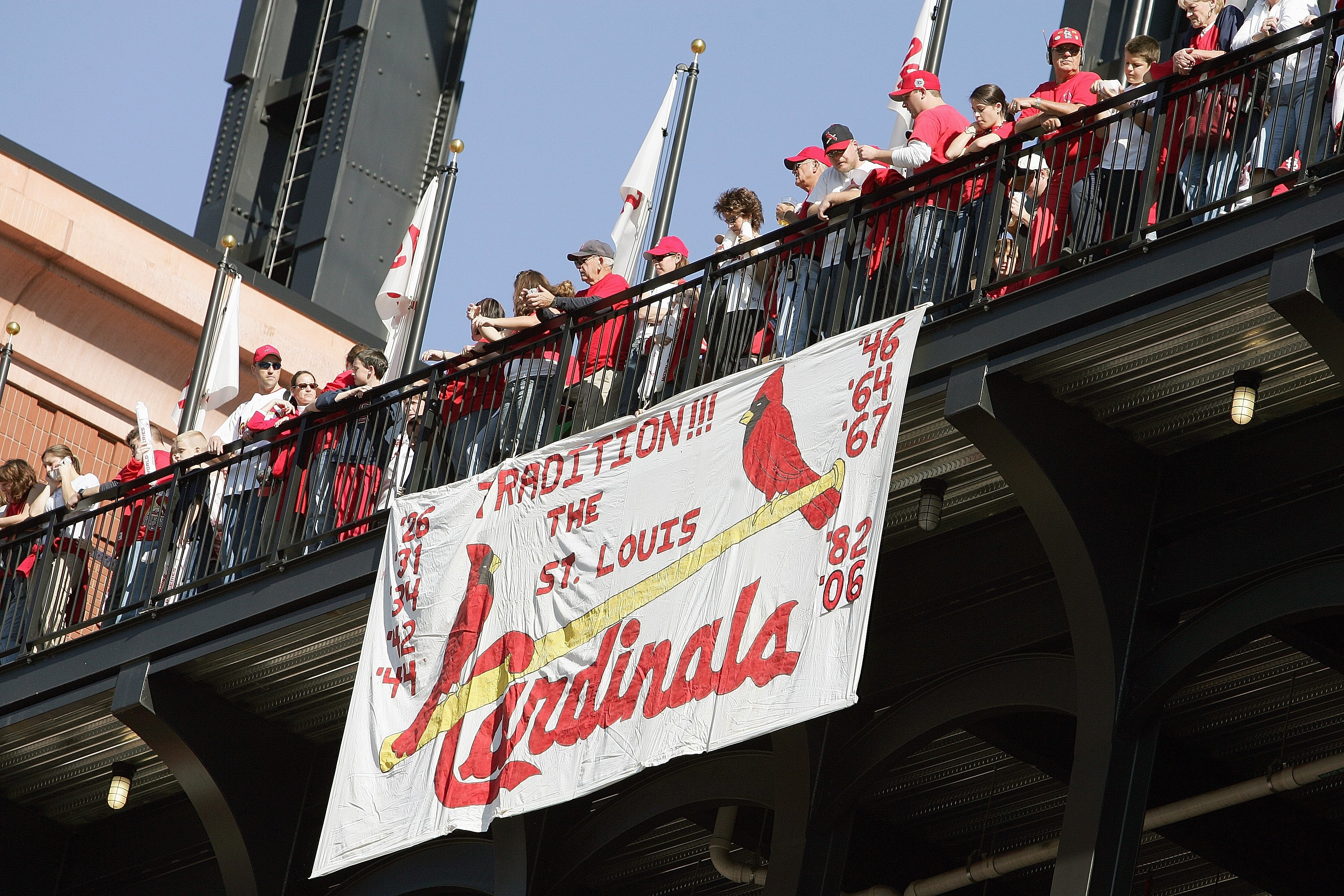 ST. LOUIS - OCTOBER 29:  Fans of the St. Louis Cardinals line the walkway above a hand made sign during the World Series Victory Parade and Rally on October 29, 2006 at Busch Stadium in St. Louis, Missouri.  (Photo by Elsa/Getty Images)