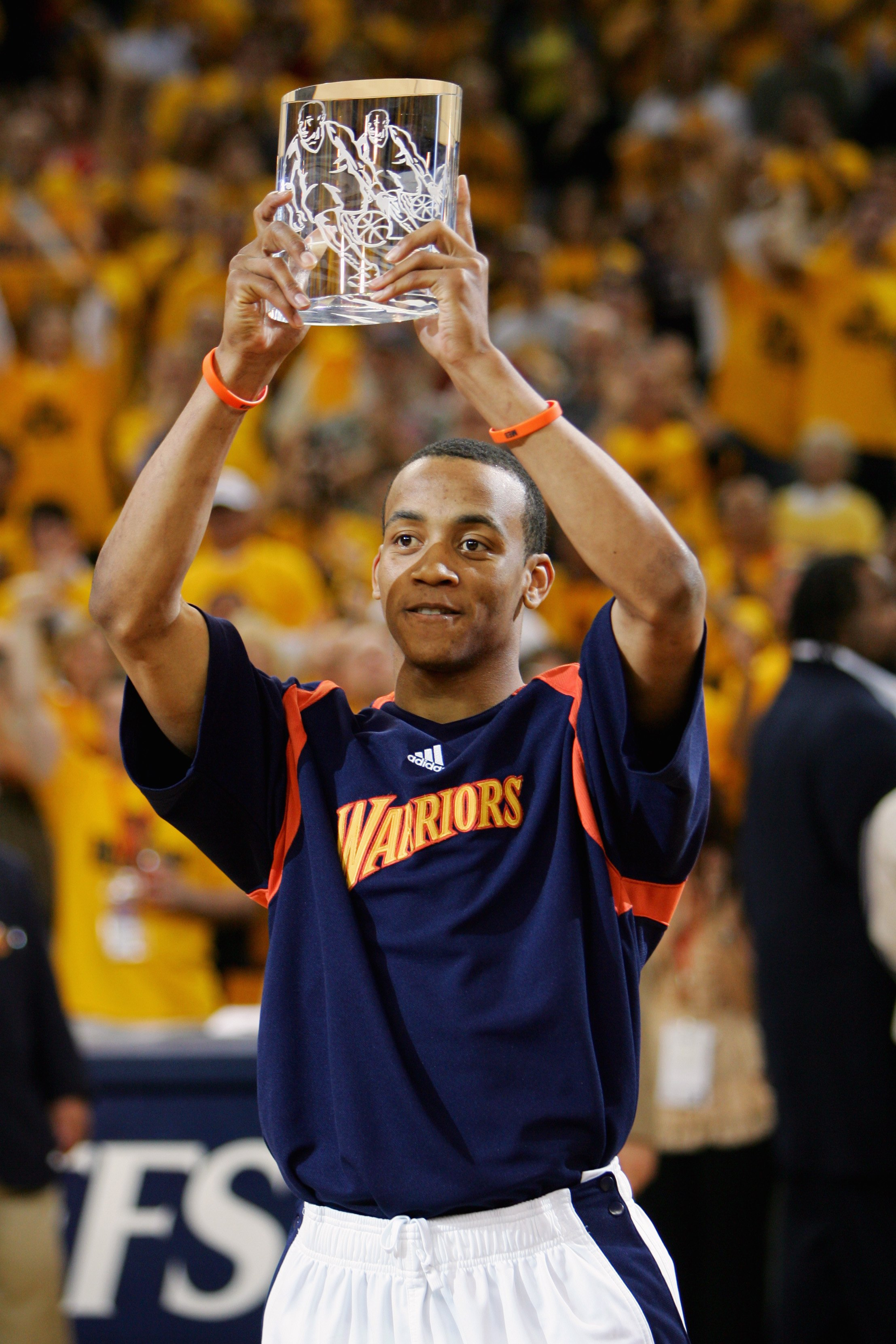 OAKLAND, CA - APRIL 27:  Monta Ellis #8 of the Golden State Warriors holds up his 'Most Improved Player' award before Game Three of the Western Conference Quarterfinals against the Dallas Mavericks during the 2007 NBA Playoffs at Oracle Arena on April 27,