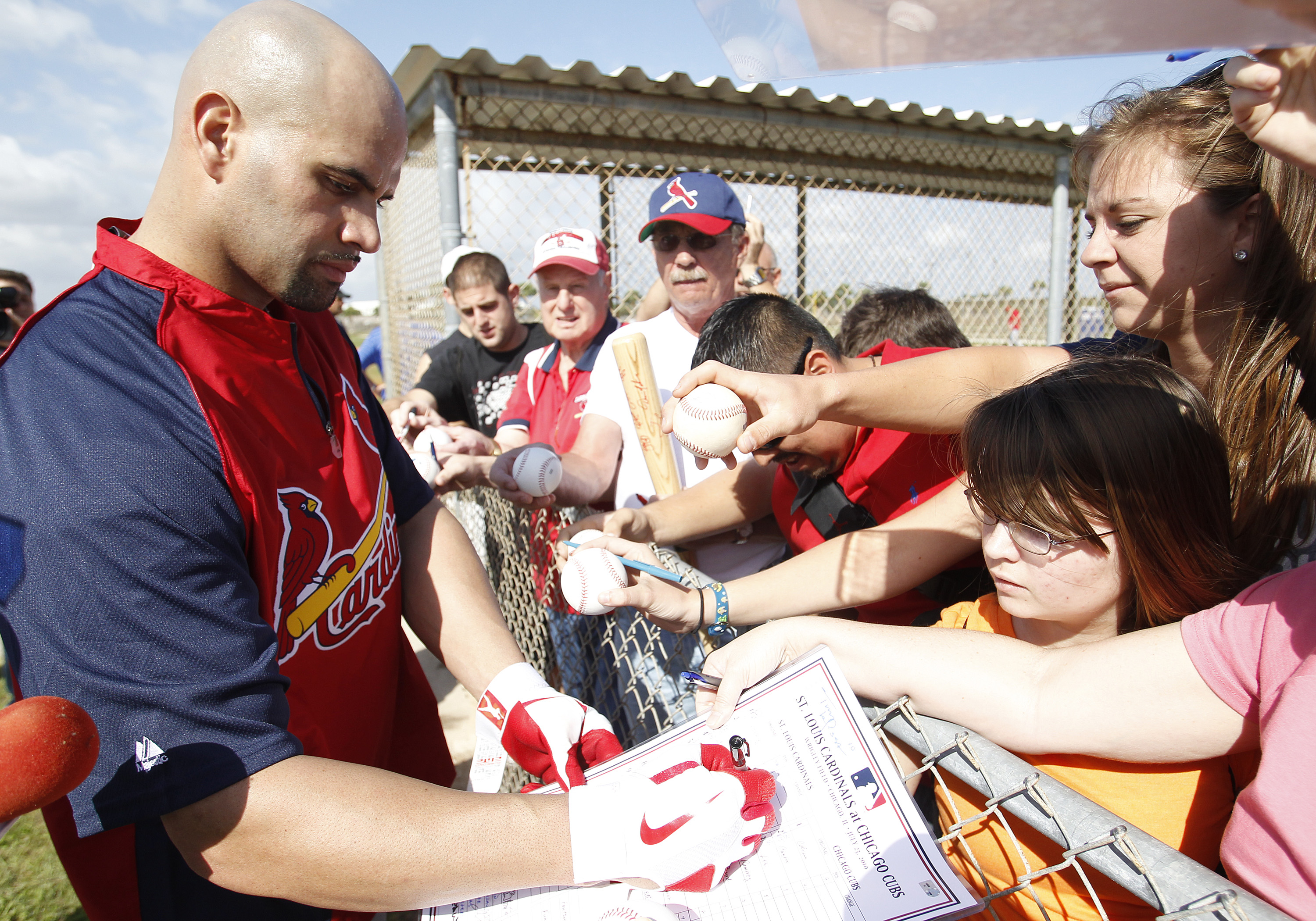 JUPITER, FL - FEBRUARY 17: Albert Pujols #5 #5 of the St. Louis Cardinals signs autographs for fans at Roger Dean Stadium on February 17, 2011 in Jupiter, Florida. (Photo by Joel Auerbach/Getty Images)