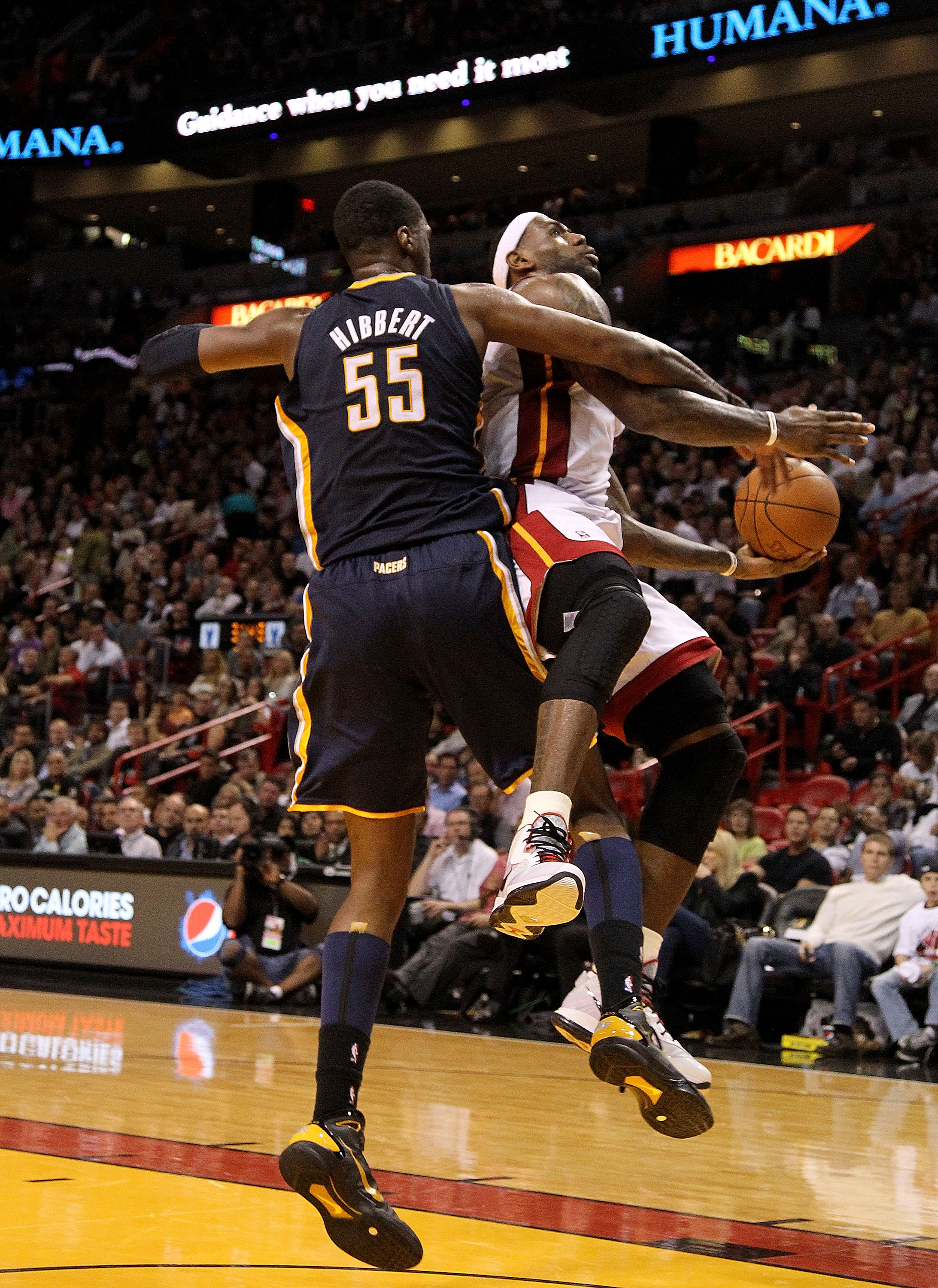 MIAMI, FL - FEBRUARY 08:  LeBron James #6 of the Miami Heat is fouled by Roy Hibbert #55 of the Indiana Pacers during a game at American Airlines Arena on February 8, 2011 in Miami, Florida. NOTE TO USER: User expressly acknowledges and agrees that, by do