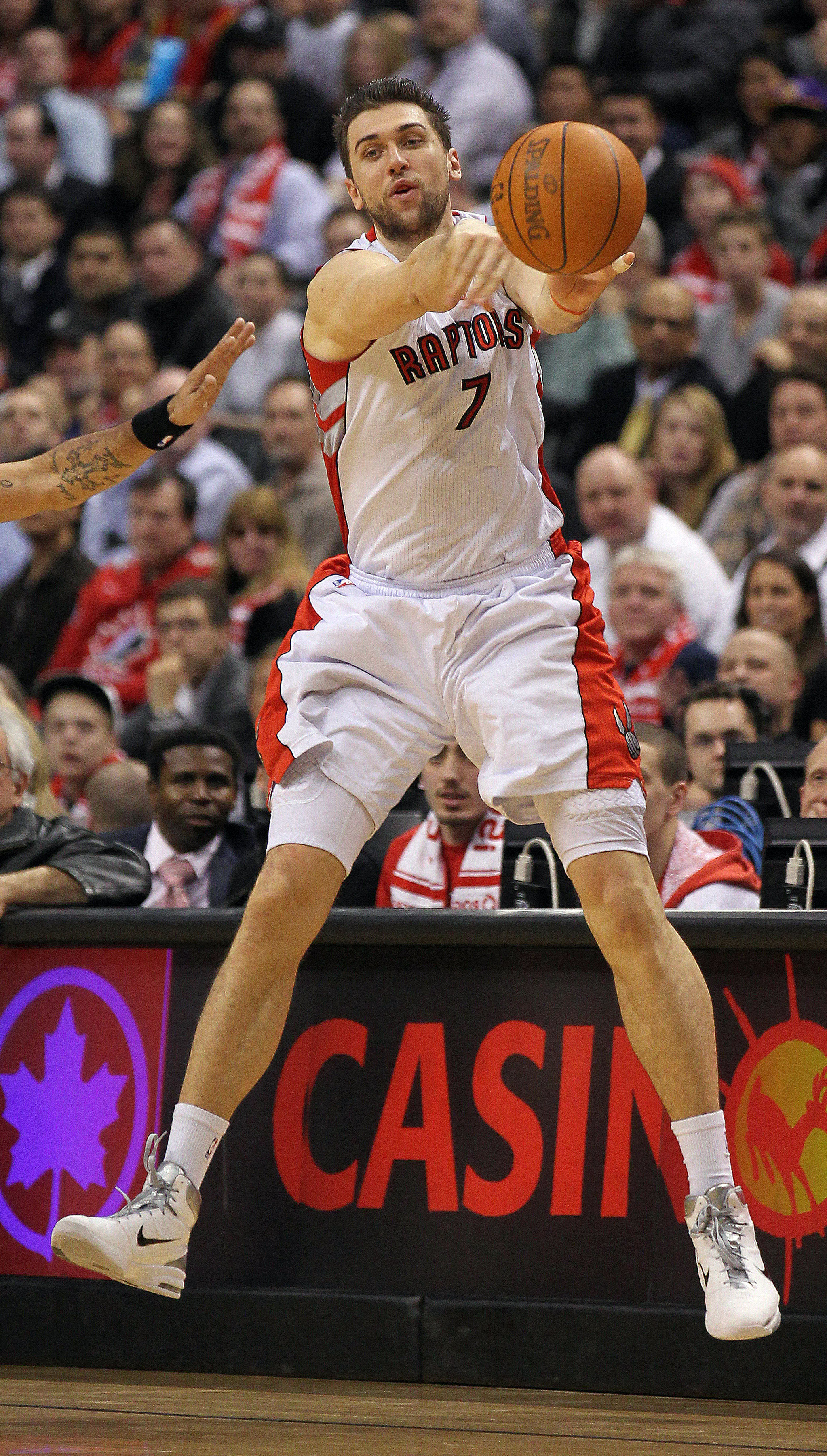 TORONTO, CANADA - FEBRUARY 16:  Andrea Bargnani #7 of the Toronto Raptors fires a pass in a game against the Miami Heat on February 16, 2011 at the Air Canada Centre in Toronto, Canada. The Heat defeated the Raptors 103-95. (Photo by Claus Andersen/Getty