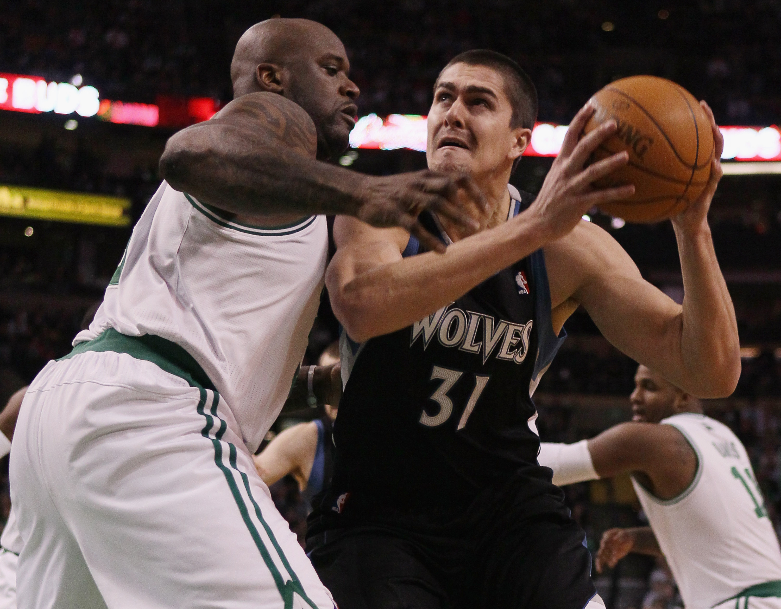 BOSTON, MA - JANUARY 03:  Darko Milicic #31 of the Minnesota Timberwolves tries to get around Shaquille O'Neal #36 of the Boston Celtics on January 3, 2011 at the TD Garden in Boston, Massachusetts. NOTE TO USER: User expressly acknowledges and agrees tha