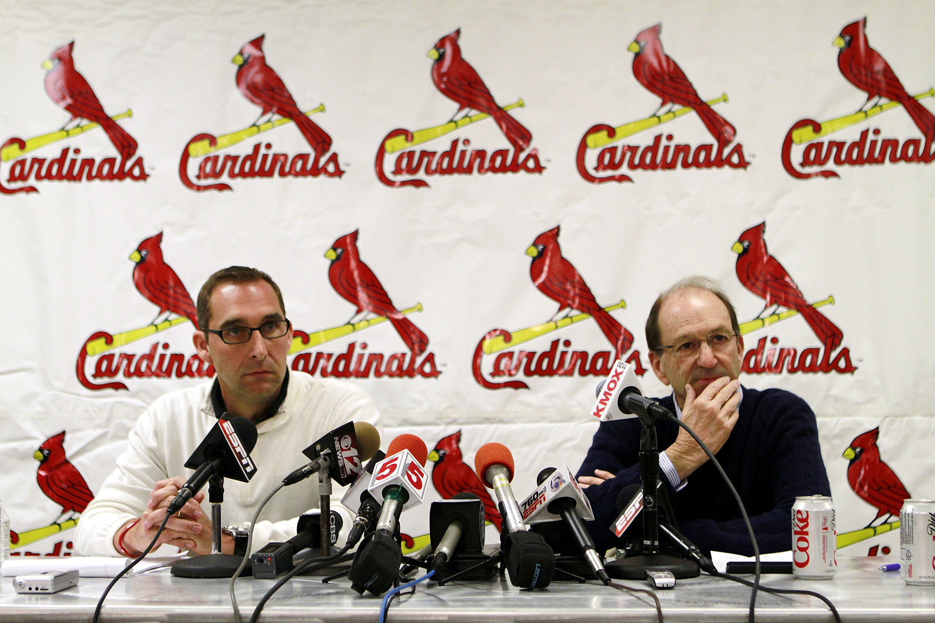 JUPITER, FL - FEBRUARY 16:  General Manager John Mozeliak (L) and owner William DeWitt, Jr. of the St. Louis Cardinals speak at a press conference at Roger Dean Stadium on February 16, 2011 in Jupiter, Florida.  (Photo by Marc Serota/Getty Images)