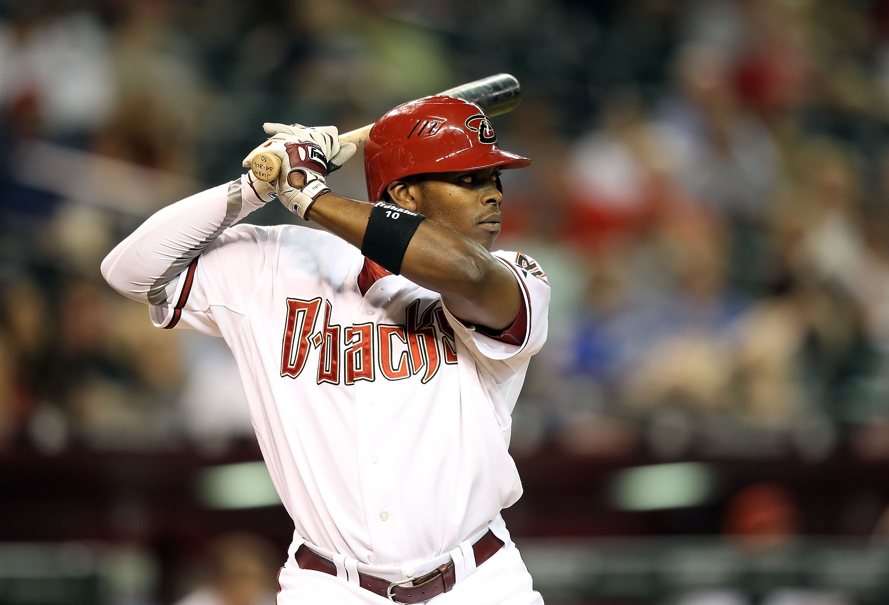 PHOENIX - JUNE 11:  Justin Upton #10 of the Arizona Diamondbacks bats against the St. Louis Cardinals during the Major League Baseball game at Chase Field on June 11, 2010 in Phoenix, Arizona. The Cardinals defeated the Diamondbacks 5-2.  (Photo by Christ