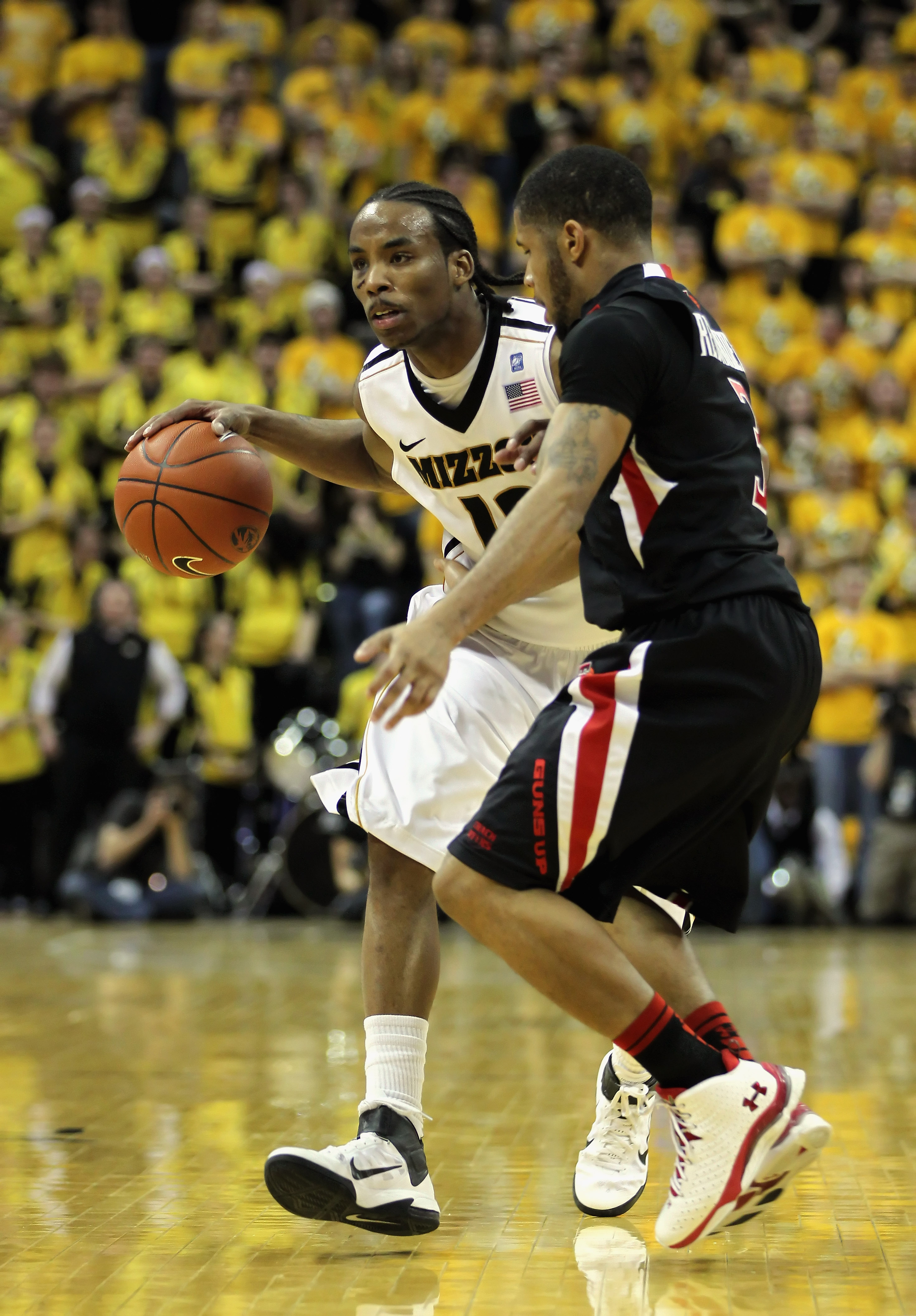 COLUMBIA, MO - FEBRUARY 15:  Marcus Denmon #12 of the Missouri Tigers controls the ball as Javarez Willis #3 of the Texas Tech Red Raiders defend during the game on February 15, 2011 at Mizzou Arena in Columbia, Missouri.  (Photo by Jamie Squire/Getty Ima