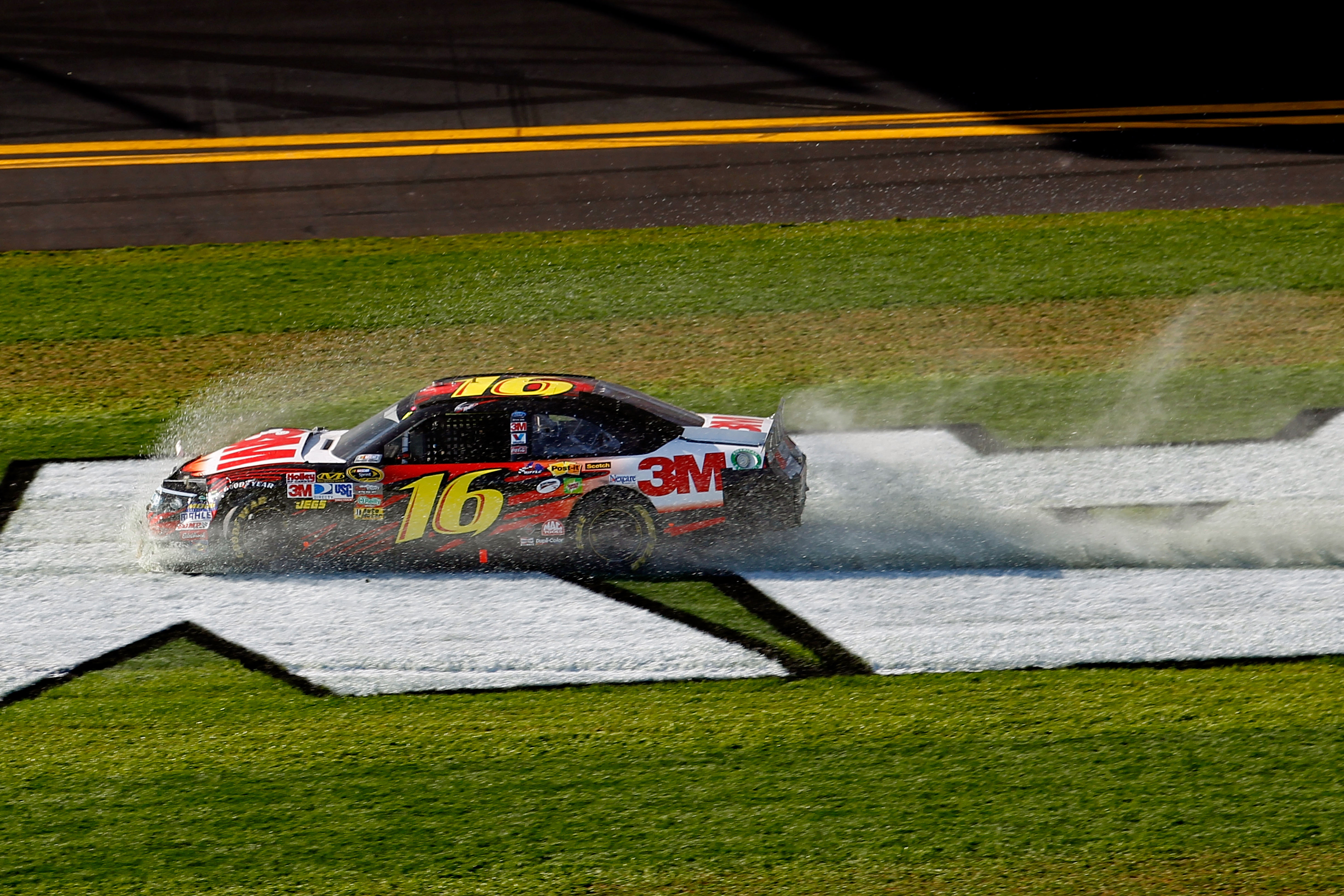 DAYTONA BEACH, FL - FEBRUARY 20:  Greg Biffle, driver of the #16 3M Ford, is involved in an incident during the NASCAR Sprint Cup Series Daytona 500 at Daytona International Speedway on February 20, 2011 in Daytona Beach, Florida.  (Photo by Todd Warshaw/