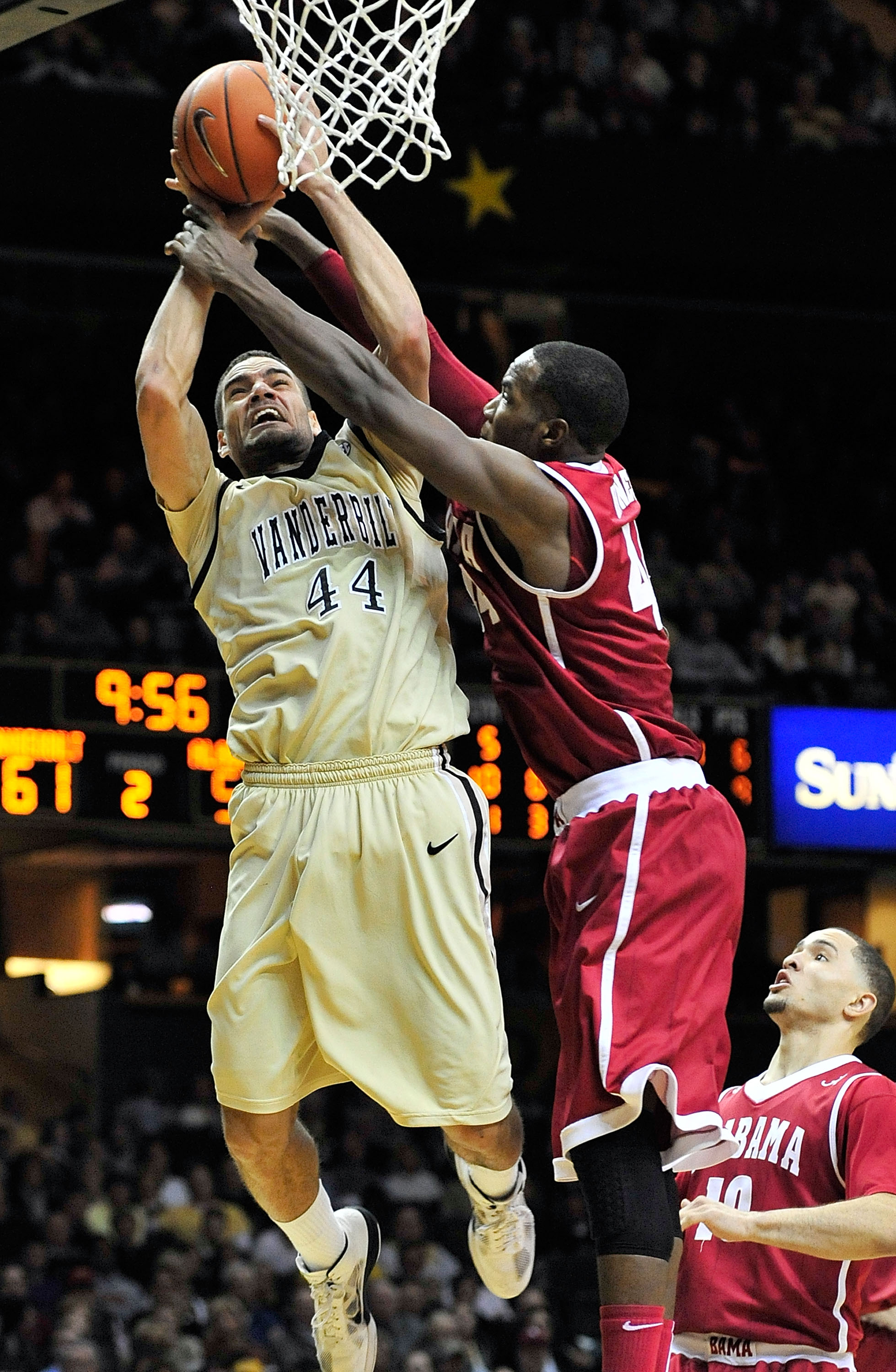 NASHVILLE, TN - FEBRUARY 10:  Jeffery Taylor #44 of the Vanderbilt Commodores is fouled by Chris Hines #44 of the Alabama Crimson Tide at Memorial Gym on February 10, 2011 in Nashville, Tennessee. Vanderbilt won 81-77. (Photo by Grant Halverson/Getty Imag