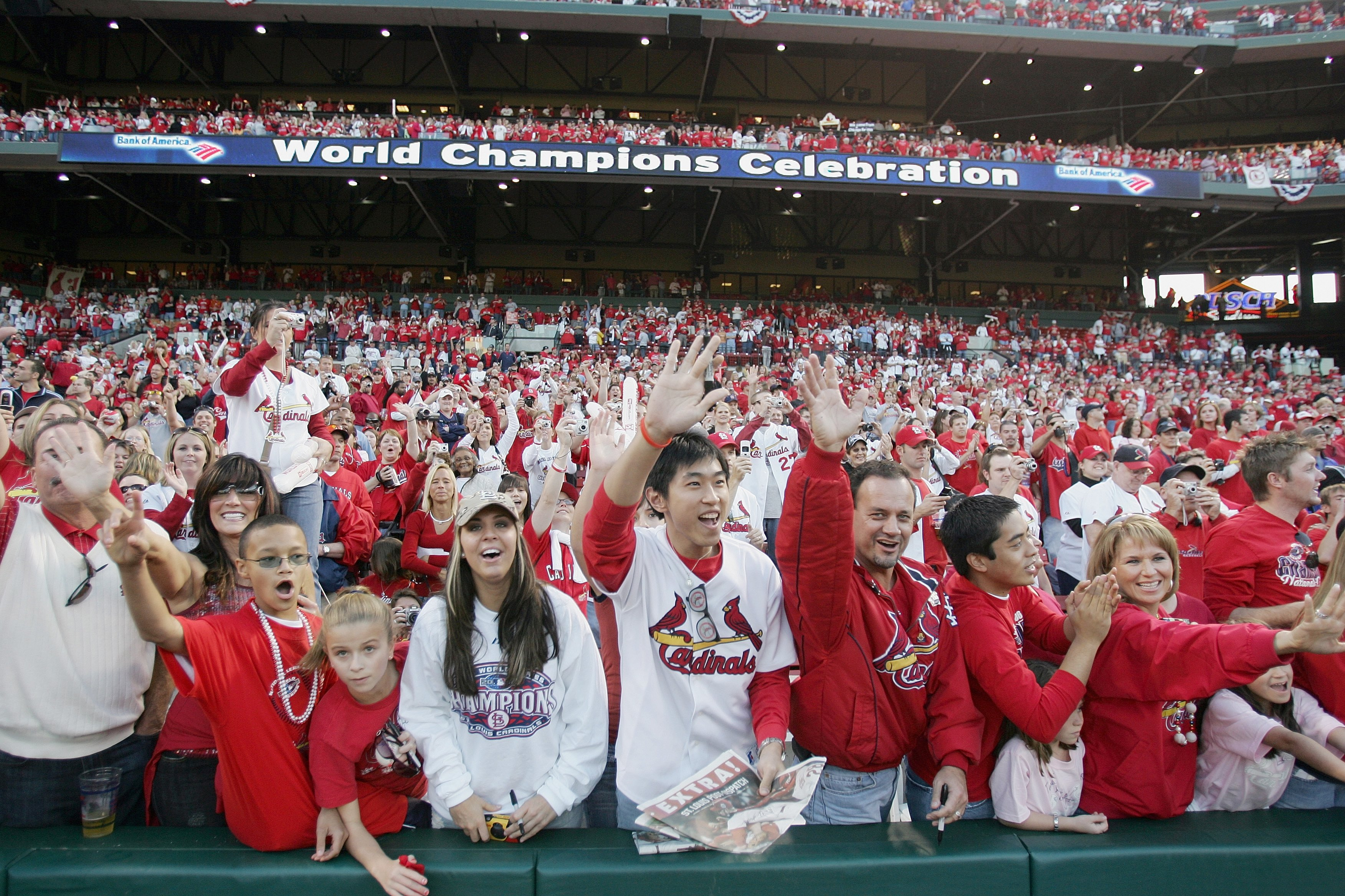 ST. LOUIS - OCTOBER 29:  Fans of the St. Louis Cardinals cheer as the players take the field  during the World Series Victory Parade and Rally on October 29, 2006 at Busch Stadium in St. Louis, Missouri.  (Photo by Elsa/Getty Images)