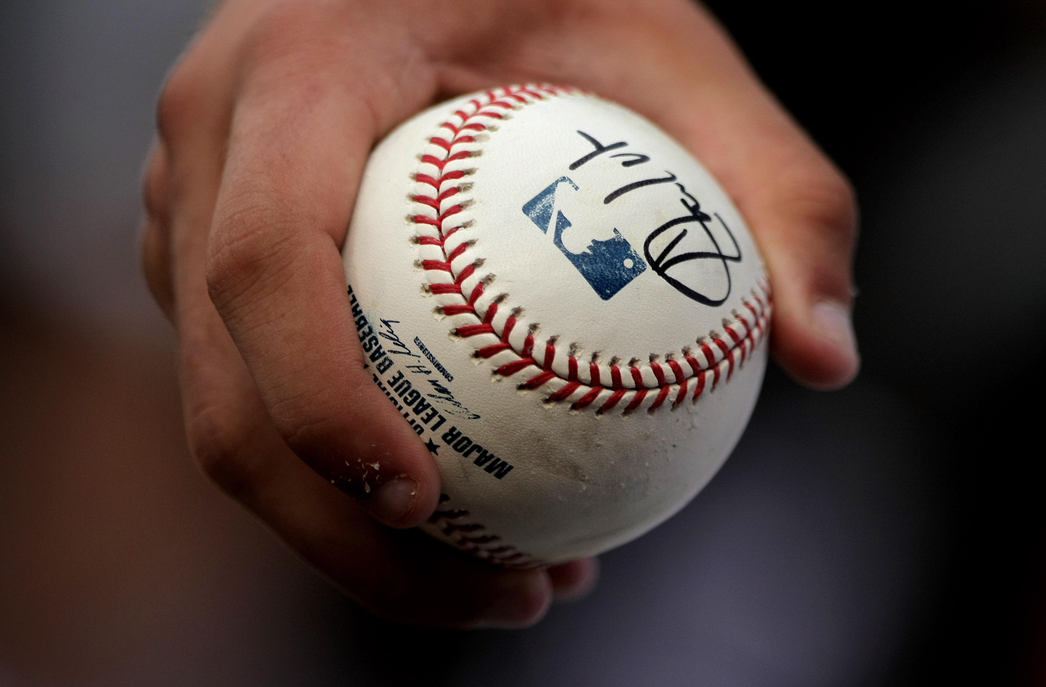 DENVER - MAY 06:  A fan holds a baseball the he got autgraphed at the game between the St. Louis Cardinals and the Colorado Rockies at Coors Field on May 6, 2008 in Denver, Colorado.  (Photo by Doug Pensinger/Getty Images)