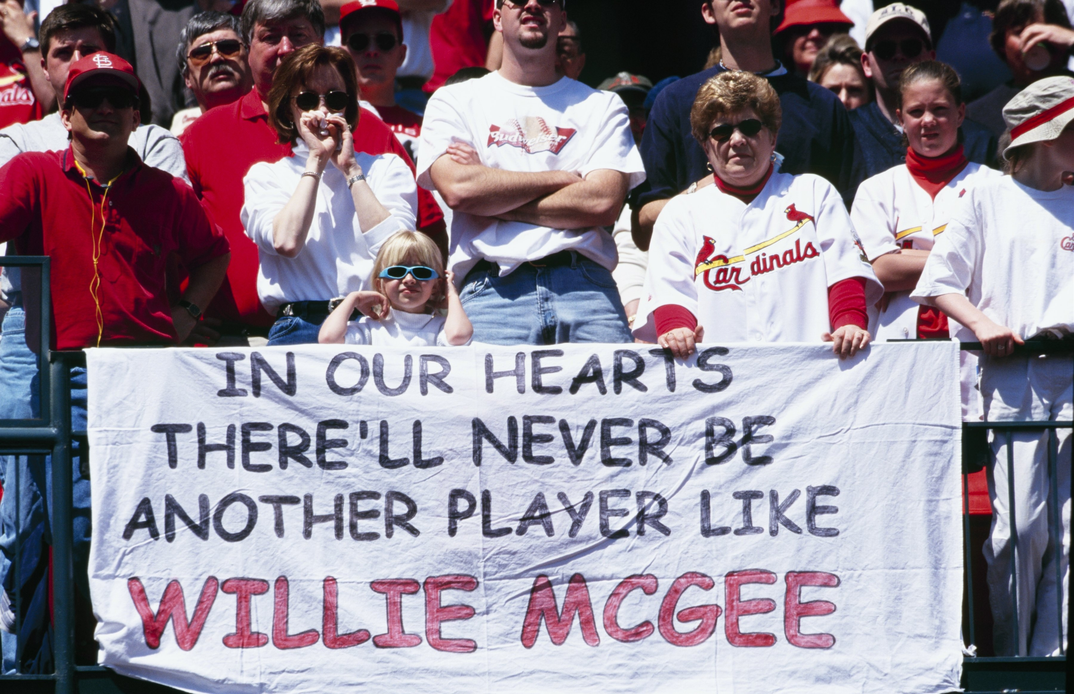 ST. LOUIS - APRIL 9:  St. Louis Cardinals fans display a banner during Willie McGee Day before the game against the Milwaukee Brewers at Busch Stadium on April 9, 2000 in St. Louis, Missouri. (Photo by Elsa/Getty Images)