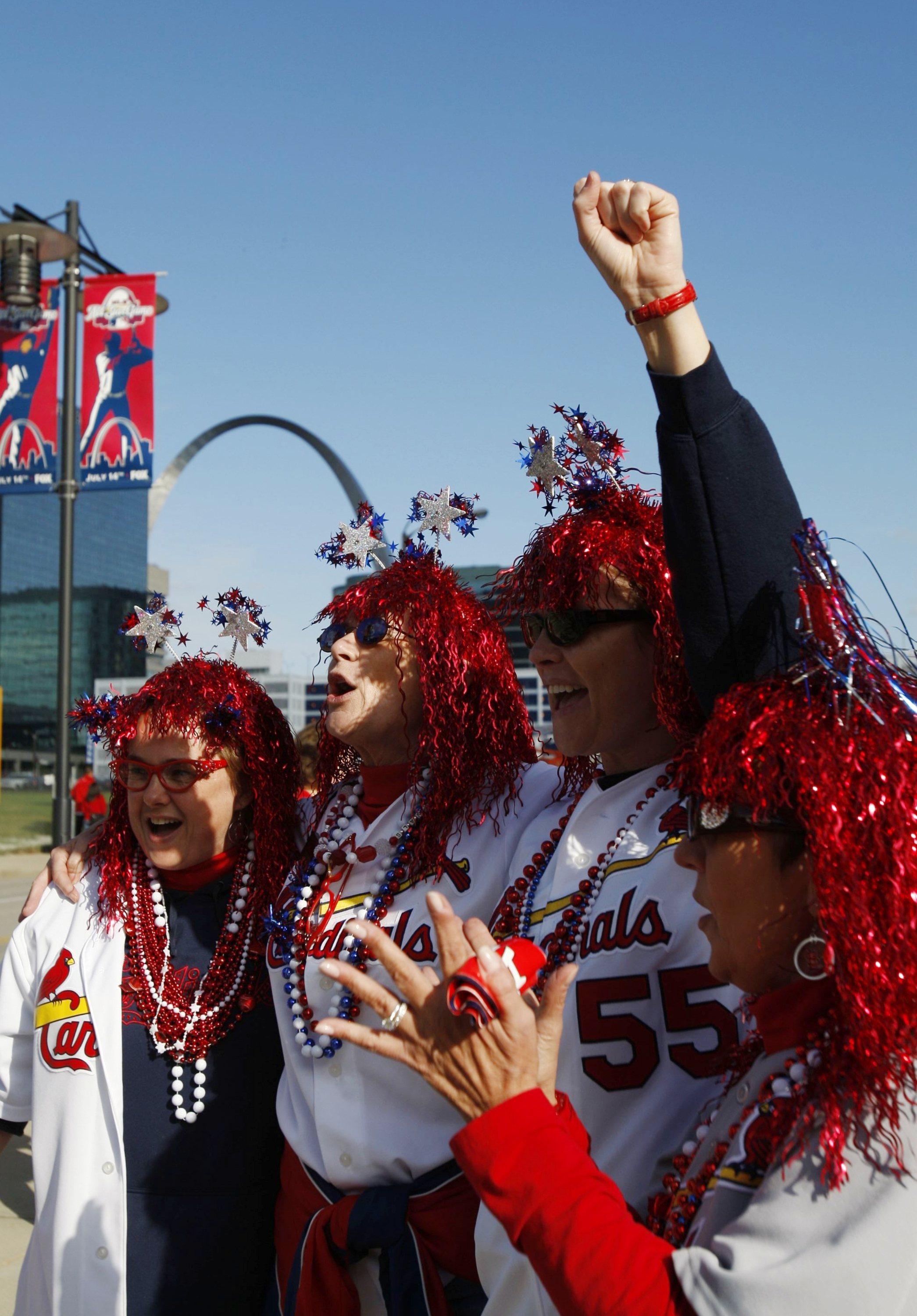 ST. LOUIS, MO - OCTOBER 10:  Fans of the St. Louis Cardinals cheer for their team before the start of Game Three of the NLDS during the 2009 MLB Playoffs against of the Los Angeles Dodgers at Busch Stadium on October 10, 2009 in St. Louis, Missouri. (Phot