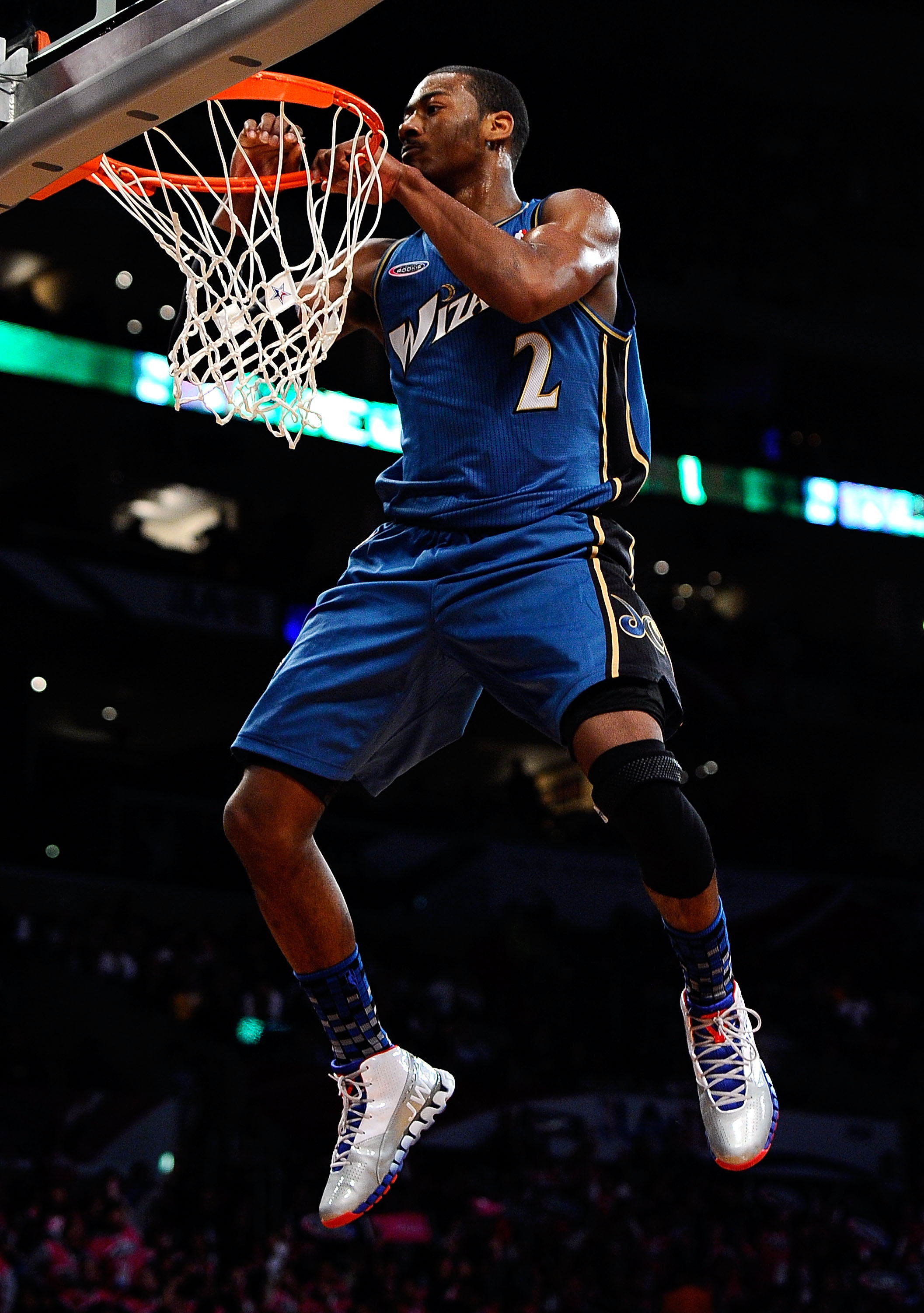 LOS ANGELES, CA - FEBRUARY 18:  John Wall #2 of the Washington Wizards and the Rookie Team hangs on the rim in the second half during the T-Mobile Rookie Challenge and Youth Jam at Staples Center on February 18, 2011 in Los Angeles, California.  (Photo by