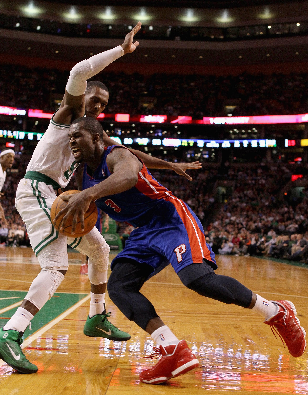 BOSTON, MA - JANUARY 19:  Rodney Stuckey #3 of the Detroit Pistons drives around Rajon Rondo #9 of the Boston Celtics on January 19, 2011 at the TD Garden in Boston, Massachusetts. The Celtics defeated the Pistons 86-82. NOTE TO USER: User expressly ackno