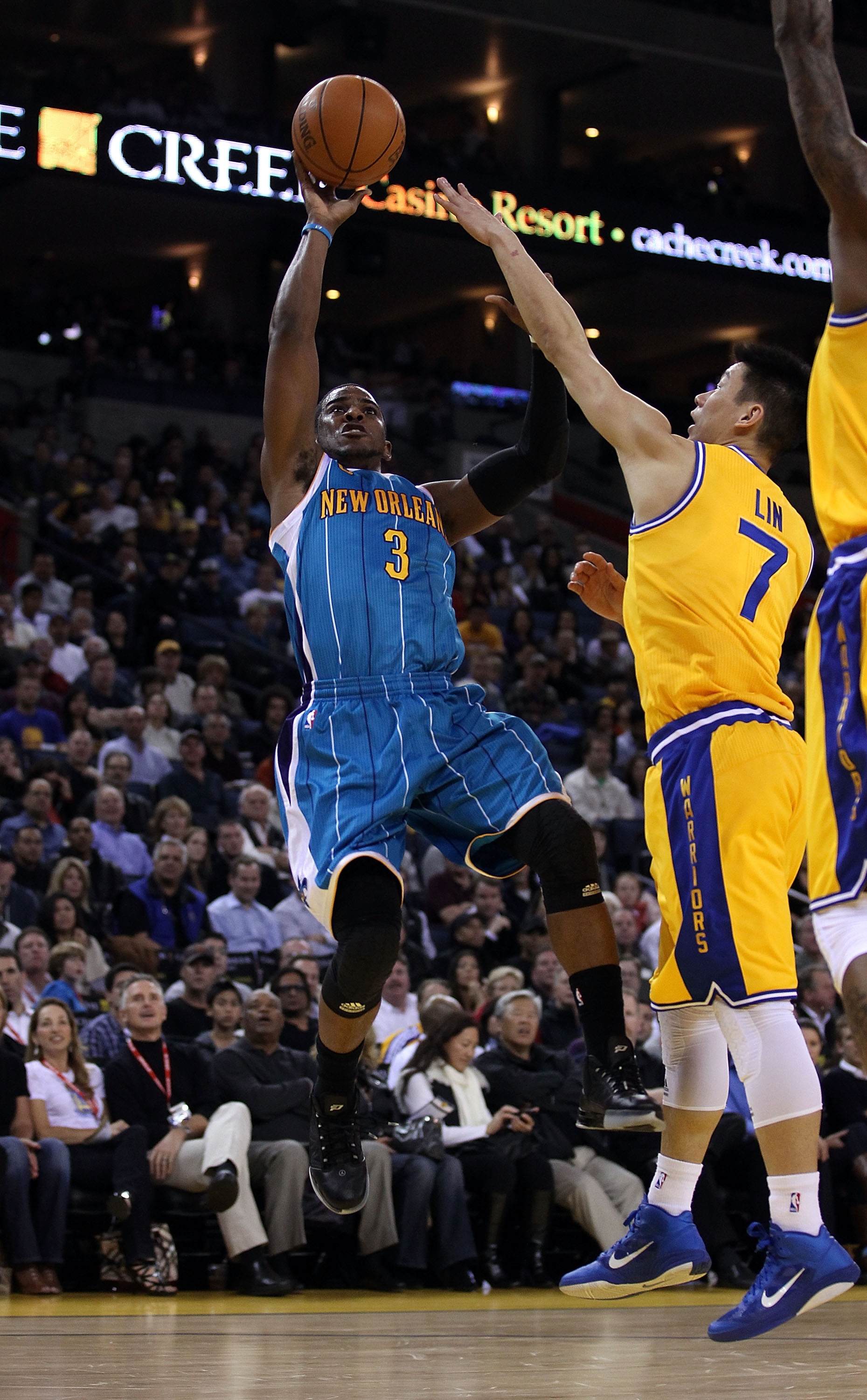 OAKLAND, CA - FEBRUARY 15:  Chris Paul #3 of the New Orleans Hornets shoots over Jeremy Lin #7 of the Golden State Warriors at Oracle Arena on February 15, 2011 in Oakland, California. NOTE TO USER: User expressly acknowledges and agrees that, by download