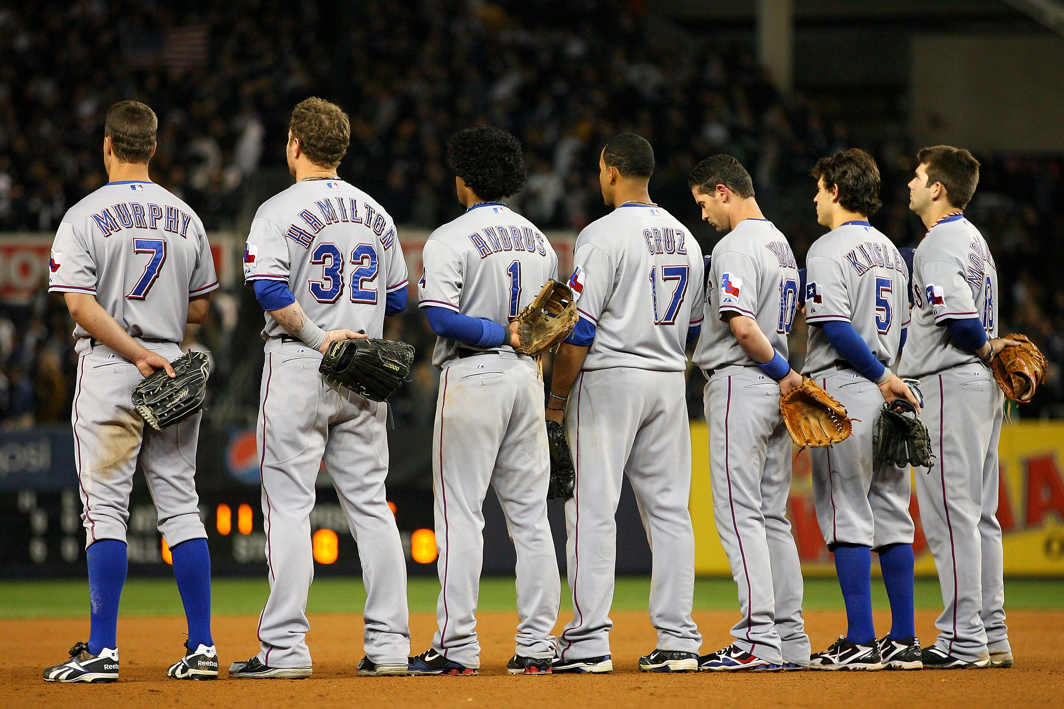 NEW YORK - OCTOBER 19:  (L-R) David Murphy #7, Josh Hamilton #32, Elvis Andrus #1, Nelson Cruz #17, Michael Young #10, Ian Kinsler #5 and Mitch Moreland #18 of the Texas Rangers stand for the performance of 'God Bless America' during the seventh inning ag