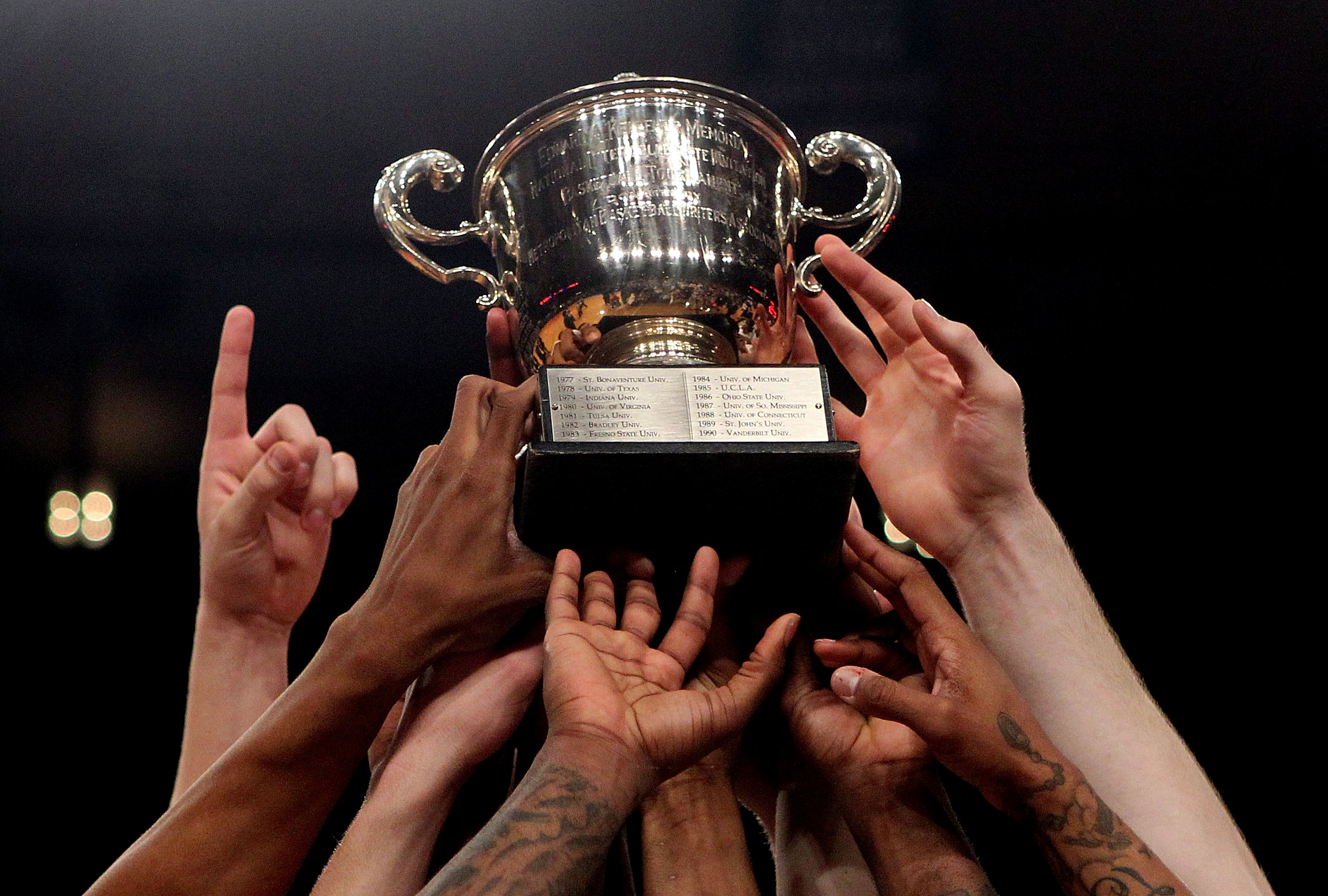 NEW YORK - APRIL 01:  The Dayton Flyers hold aloft the trophy to celebrate defeating the North Carolina Tar Heels during the 2010 NIT Championship Game at Madison Square Garden on April 1, 2010 in New York, New York.  (Photo by Nick Laham/Getty Images)