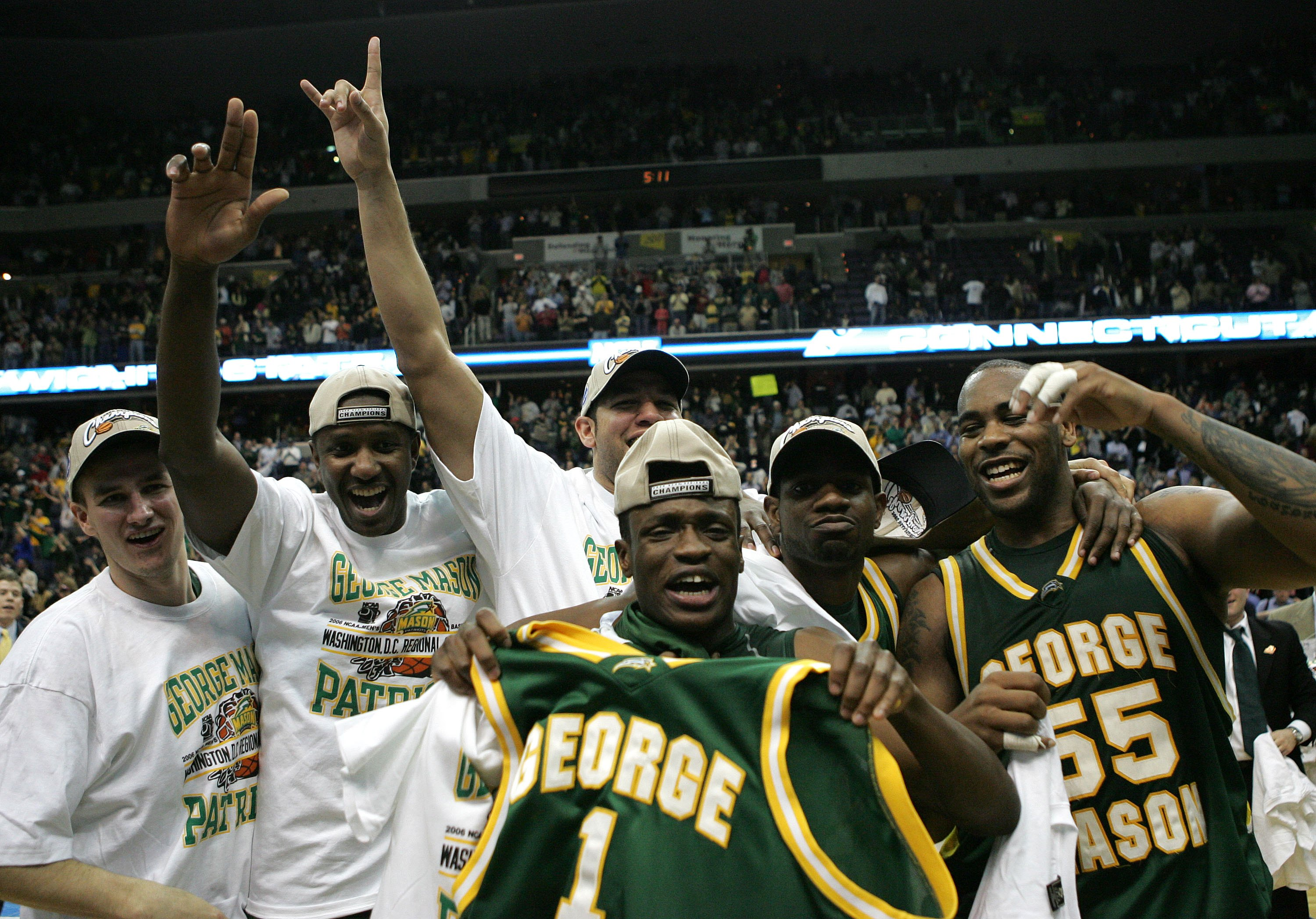 WASHINGTON - MARCH 26:  Tony Skinn #1, Jai Lewis #55 and their teammates celebrate thier win over the Connecticut Huskies during the Regional Finals of the NCAA Men's Basketball Tournament on March 26, 2006 at the Verizon Center in Washington DC. The Geor