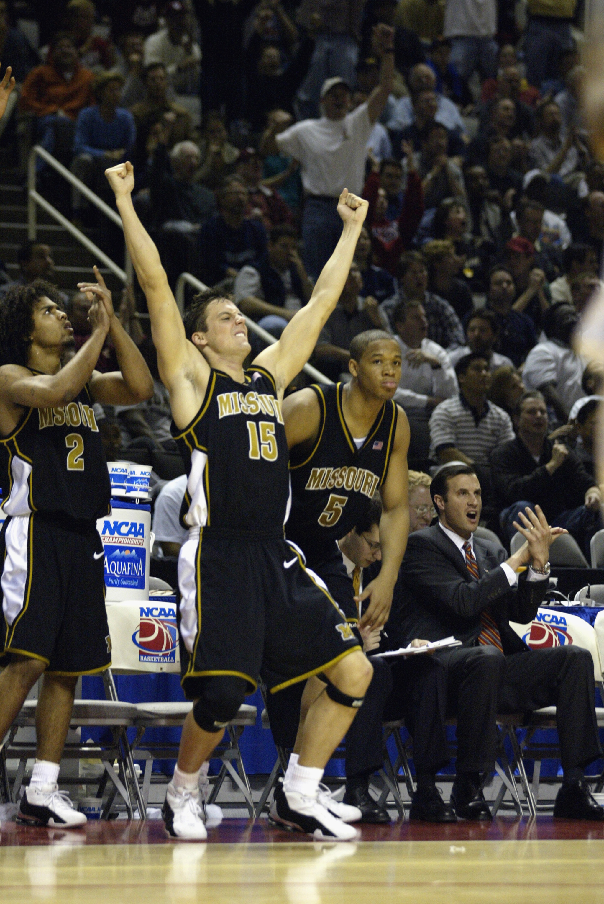 SAN JOSE, CA - MARCH 21:  Josh Kroenke #15 of the Missouri Tigers celebrates the win over the UCLA Bruins during the West Regional Semifinal Game of the 2002 NCAA Basketball Tournament on March 21, 2002 at Compaq Center in San Jose, California.  The Tiger