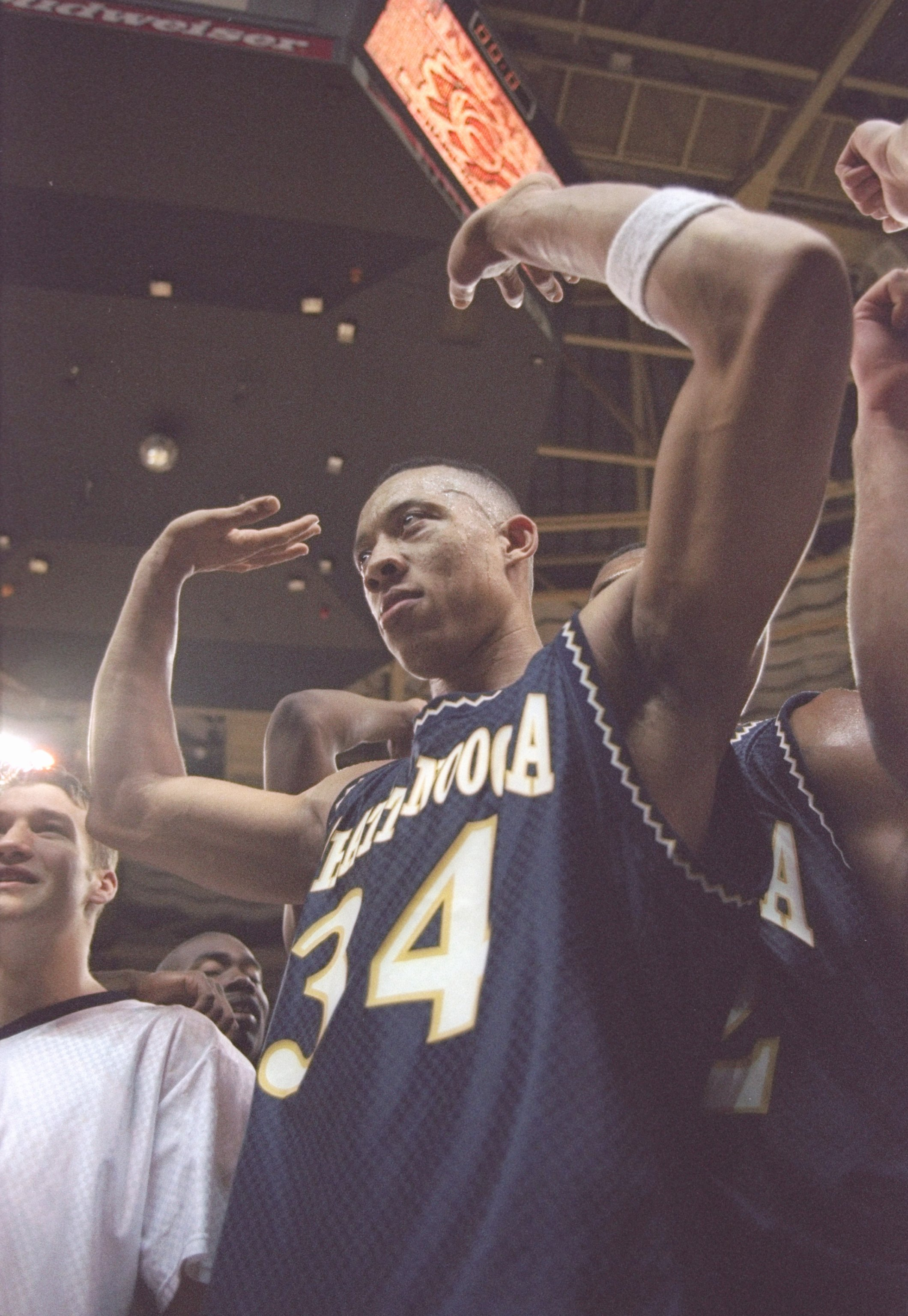 16 Mar 1997: Center Chris Mims of University of Tennessee at Chattanooga Moccasins celebrates after a playoff game against the Illinois Fighting Illini at the Charlotte Coliseum in Charlotte, North Carolina. Chatanooga won the game 73 - 63.