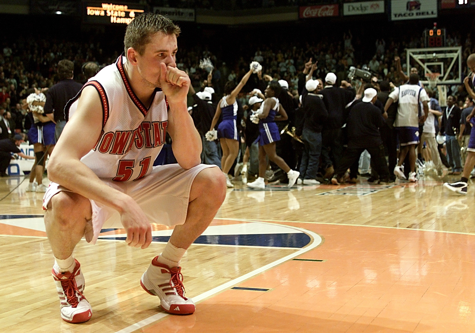 15 Mar 2001:  Forward Martin Rancik #51 of the Iowa State Cyclones ponders losing as the Hampton Pirates celebrate during the first round of the NCAA Tournament at the Boise State University Pavilion in Boise, Idaho. The Pirates upset the Cyclones 58-57.