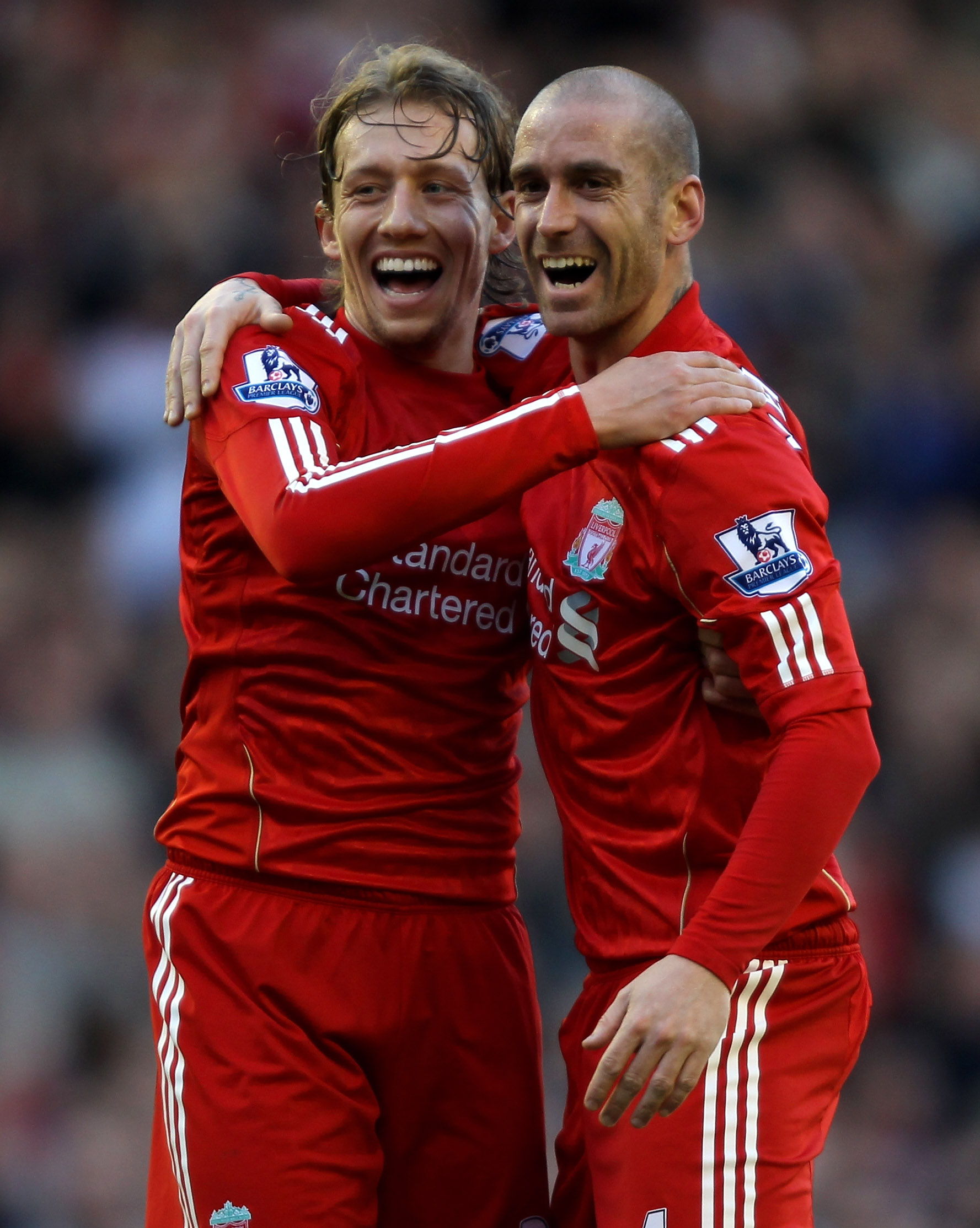 LIVERPOOL, ENGLAND - FEBRUARY 12:  Raul Meireles (R) of Liverpool celebrates scoring the opening goal with team mate Lucas during the Barclays Premier League match between Liverpool and Wigan Athletic at Anfield on February 12, 2011 in Liverpool, England.