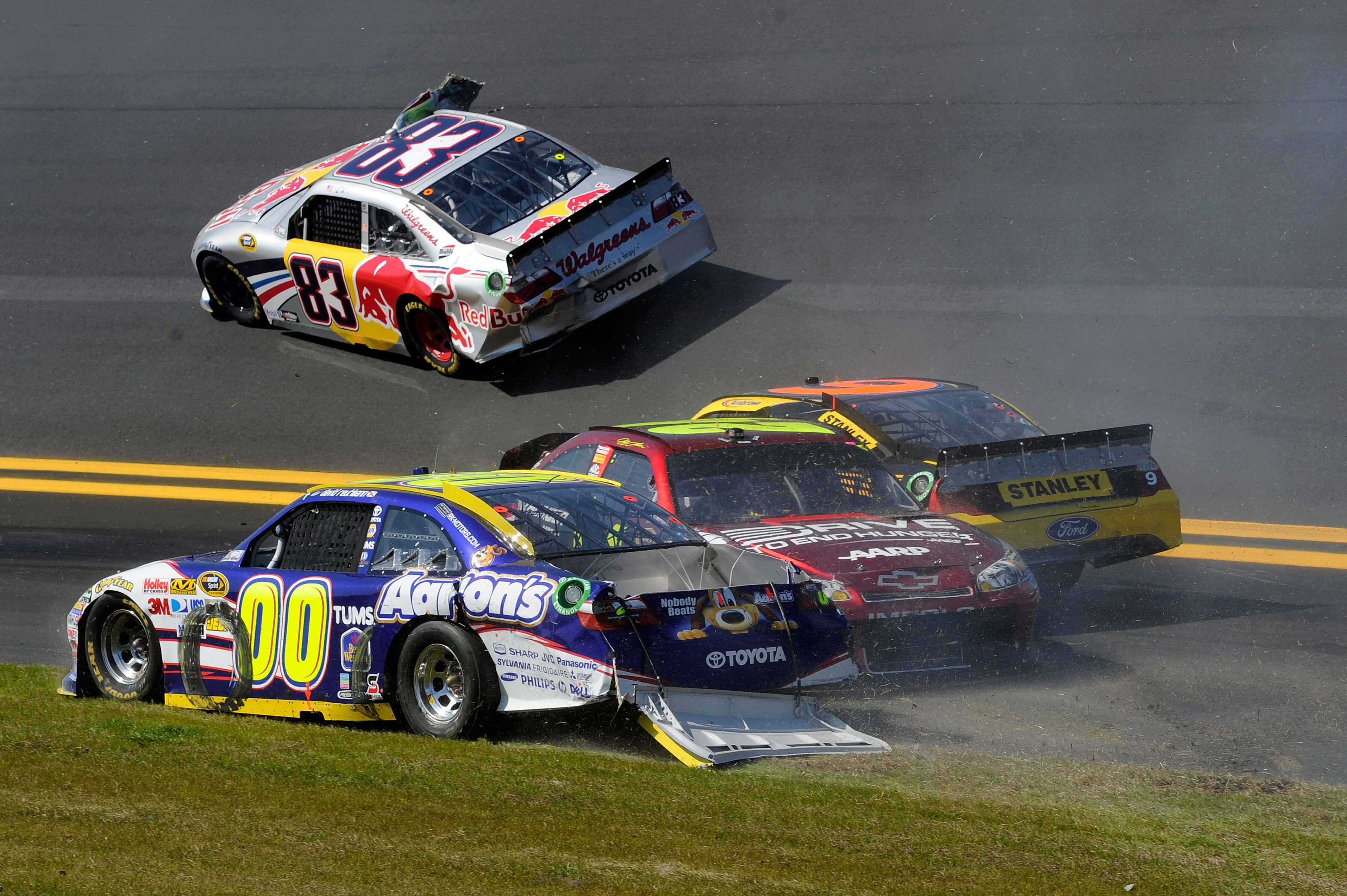 DAYTONA BEACH, FL - FEBRUARY 20:  Brian Vickers, driver of the #83 Red Bull Toyota, Marcos Ambrose, driver of the #9 Stanley Ford, Jeff Gordon, driver of the #24 Drive to End Hunger Chevrolet, and David Reutimann, driver of the #00 Aaron's Dream Machine T