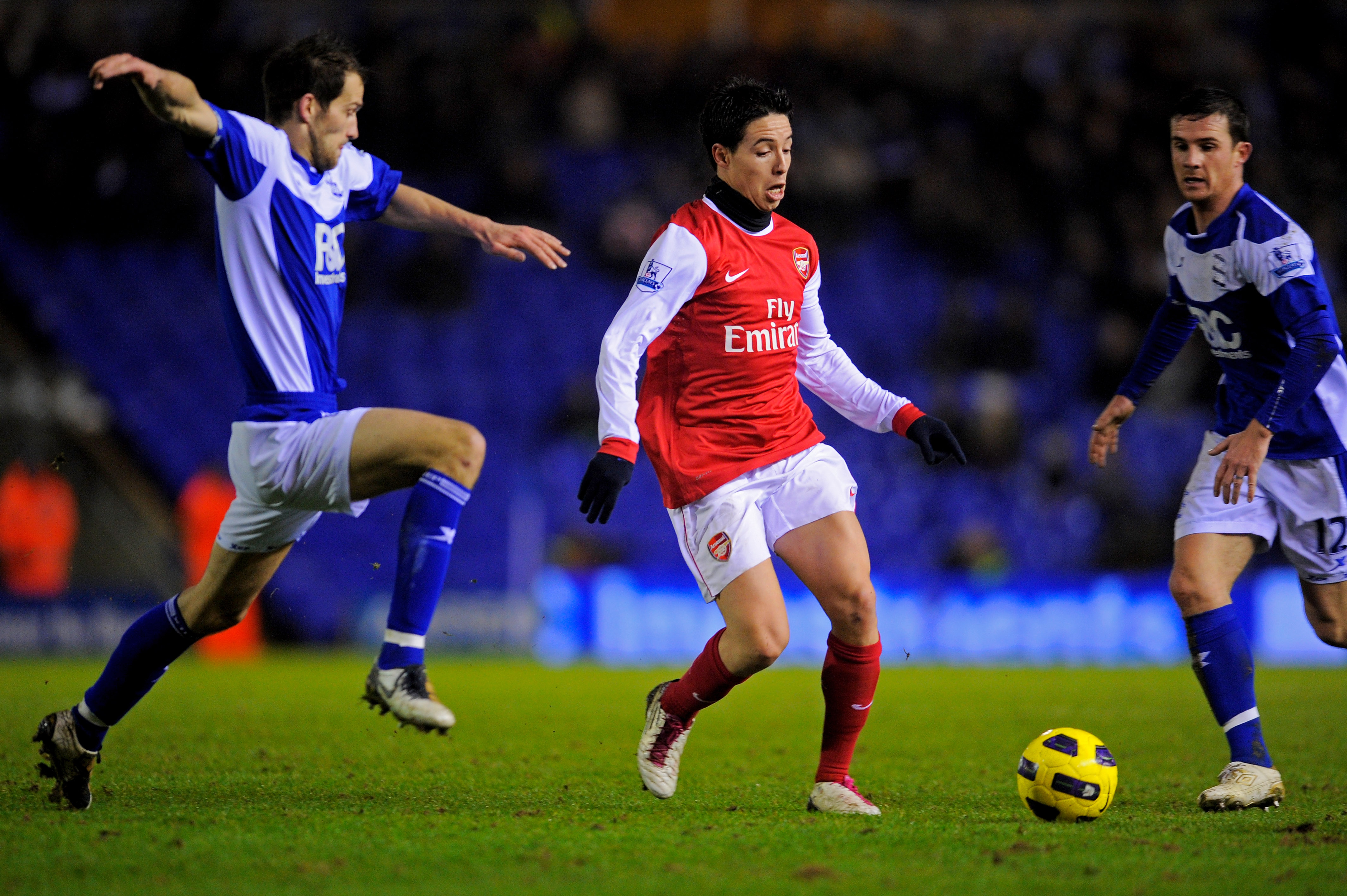 BIRMINGHAM, ENGLAND - JANUARY 01:  Samir Nasri of Arsenal is challenged by Roger Johnson of Birmingham during the Barclays Premier Leaue match between Birmingham City and Arsenal at St. Andrews on January 1, 2011 in Birmingham, England.  (Photo by Michael