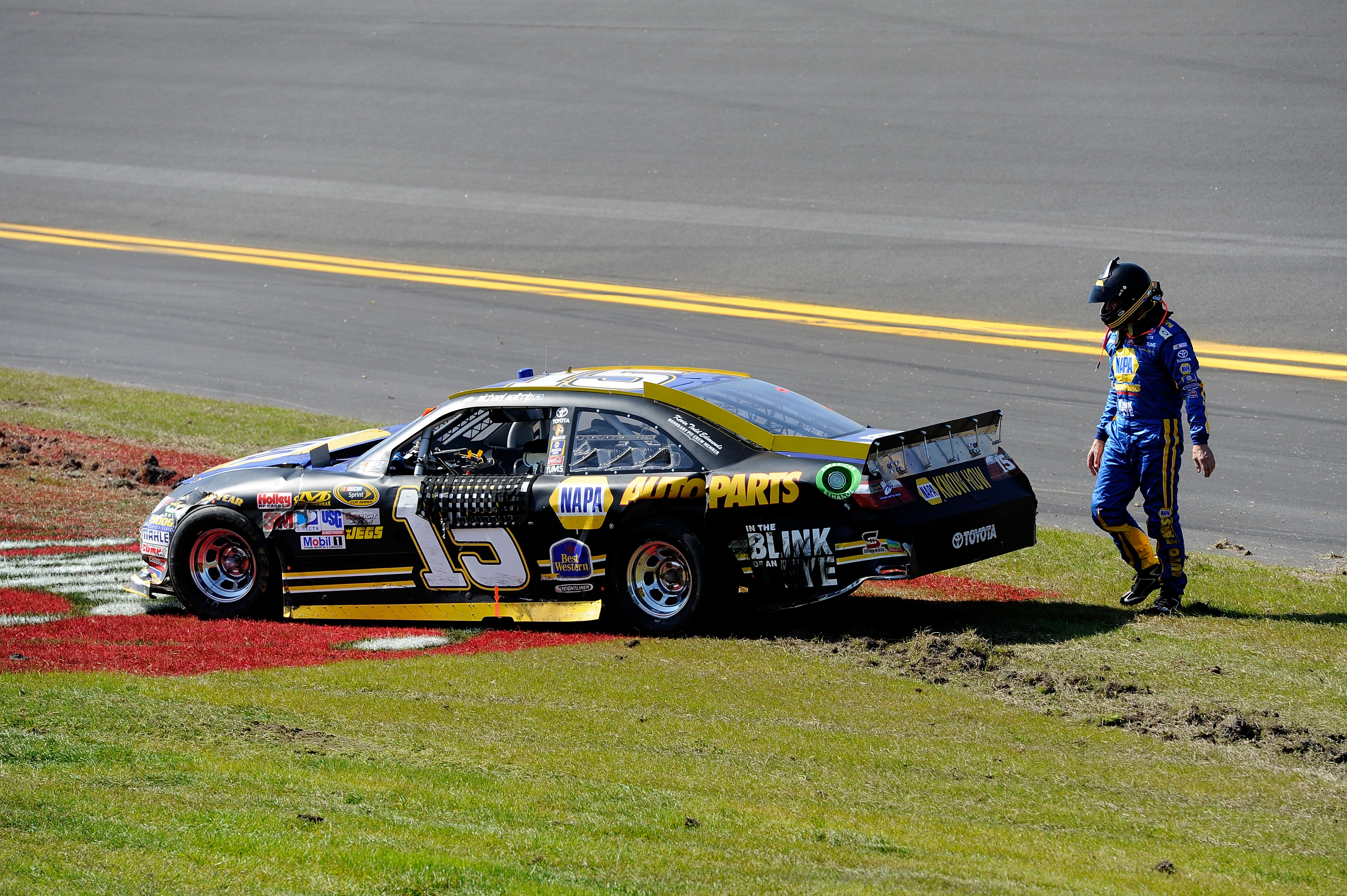 DAYTONA BEACH, FL - FEBRUARY 20:  Michael Waltrip, driver of the #15 NAPA Auto Parts Toyota, looks at his car after an incident during the NASCAR Sprint Cup Series Daytona 500 at Daytona International Speedway on February 20, 2011 in Daytona Beach, Florid