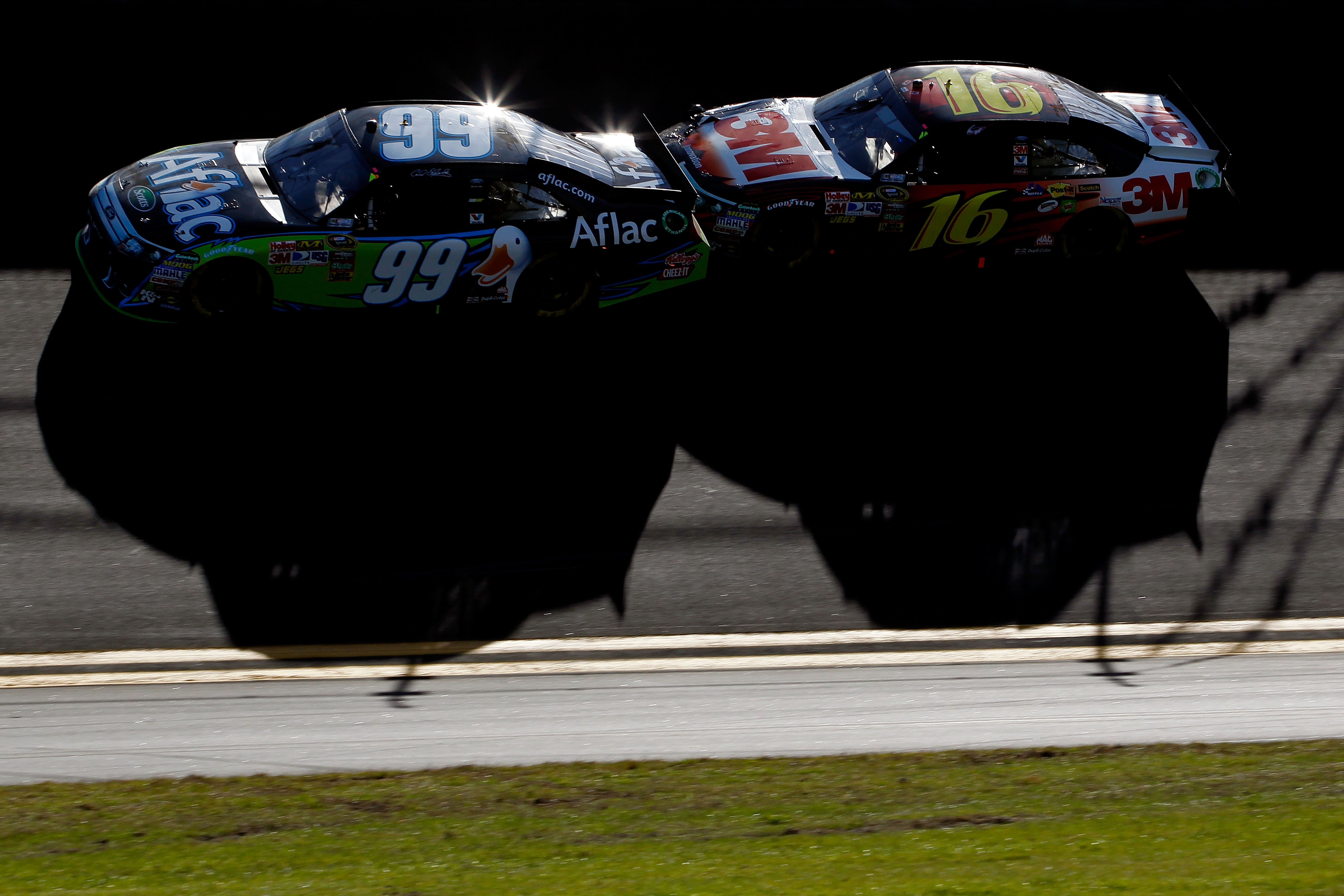 DAYTONA BEACH, FL - FEBRUARY 20:  Carl Edwards, driver of the #99 Aflac Ford, and Greg Biffle, driver of the #16 3M Ford, race during the NASCAR Sprint Cup Series Daytona 500 at Daytona International Speedway on February 20, 2011 in Daytona Beach, Florida