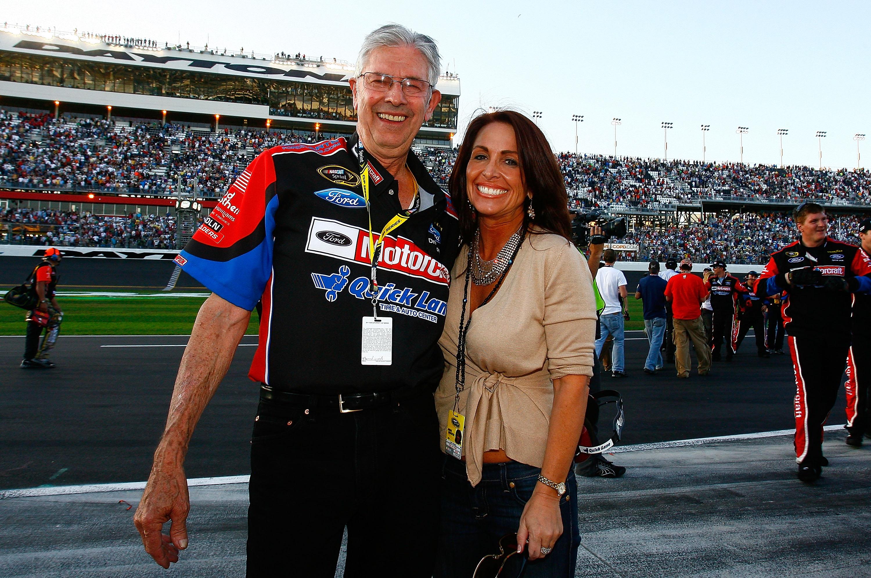 DAYTONA BEACH, FL - FEBRUARY 20:  NASCAR legend Leonard Wood celebrates Lori Banks with after Trevor Bayne, driver of the #21 Motorcraft/Quick Lane Ford, won the NASCAR Sprint Cup Series Daytona 500 at Daytona International Speedway on February 20, 2011 i