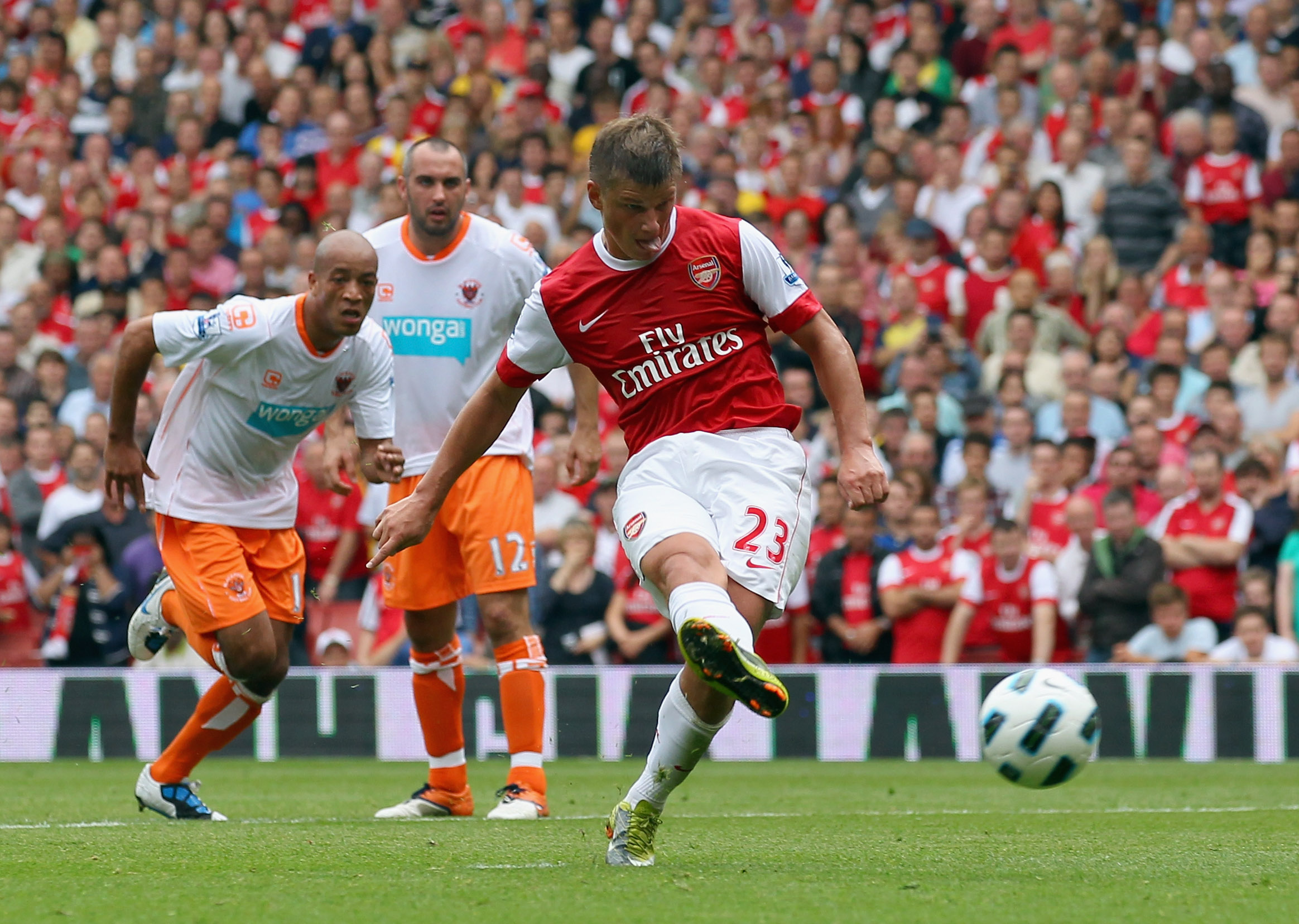 LONDON, ENGLAND - AUGUST 21: Andrey Arshavin of Arsenal scores a penalty during the Barclays Premier League match between Arsenal and Blackpool at The Emirates Stadium on August 21, 2010 in London, England.  (Photo by Clive Rose/Getty Images)