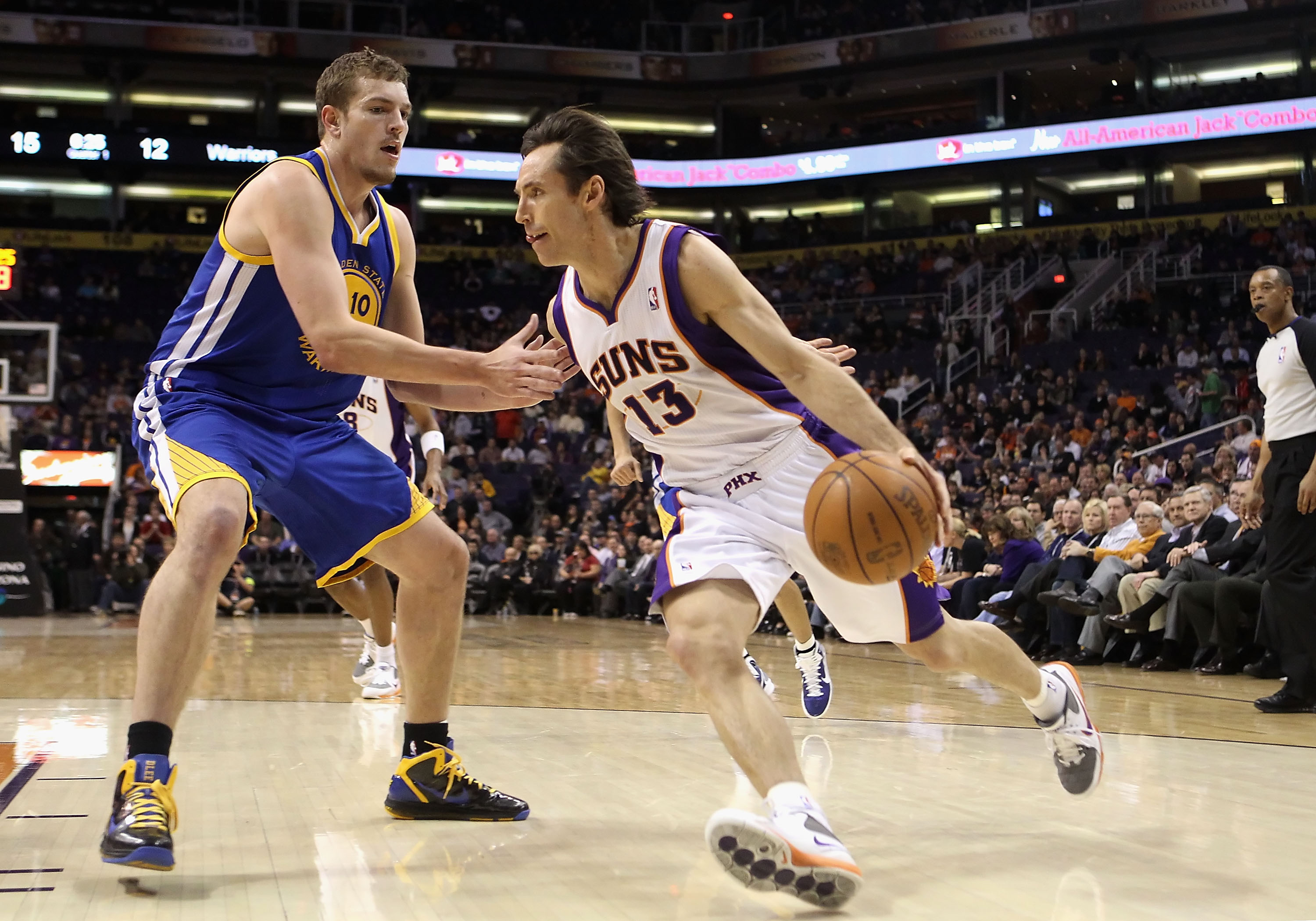 PHOENIX, AZ - FEBRUARY 10:  Steve Nash #13 of the Phoenix Suns drives the ball during the NBA game against the Golden State Warriors at US Airways Center on February 10, 2011 in Phoenix, Arizona.  The Suns defeated the Warriors 112-88.  NOTE TO USER: User