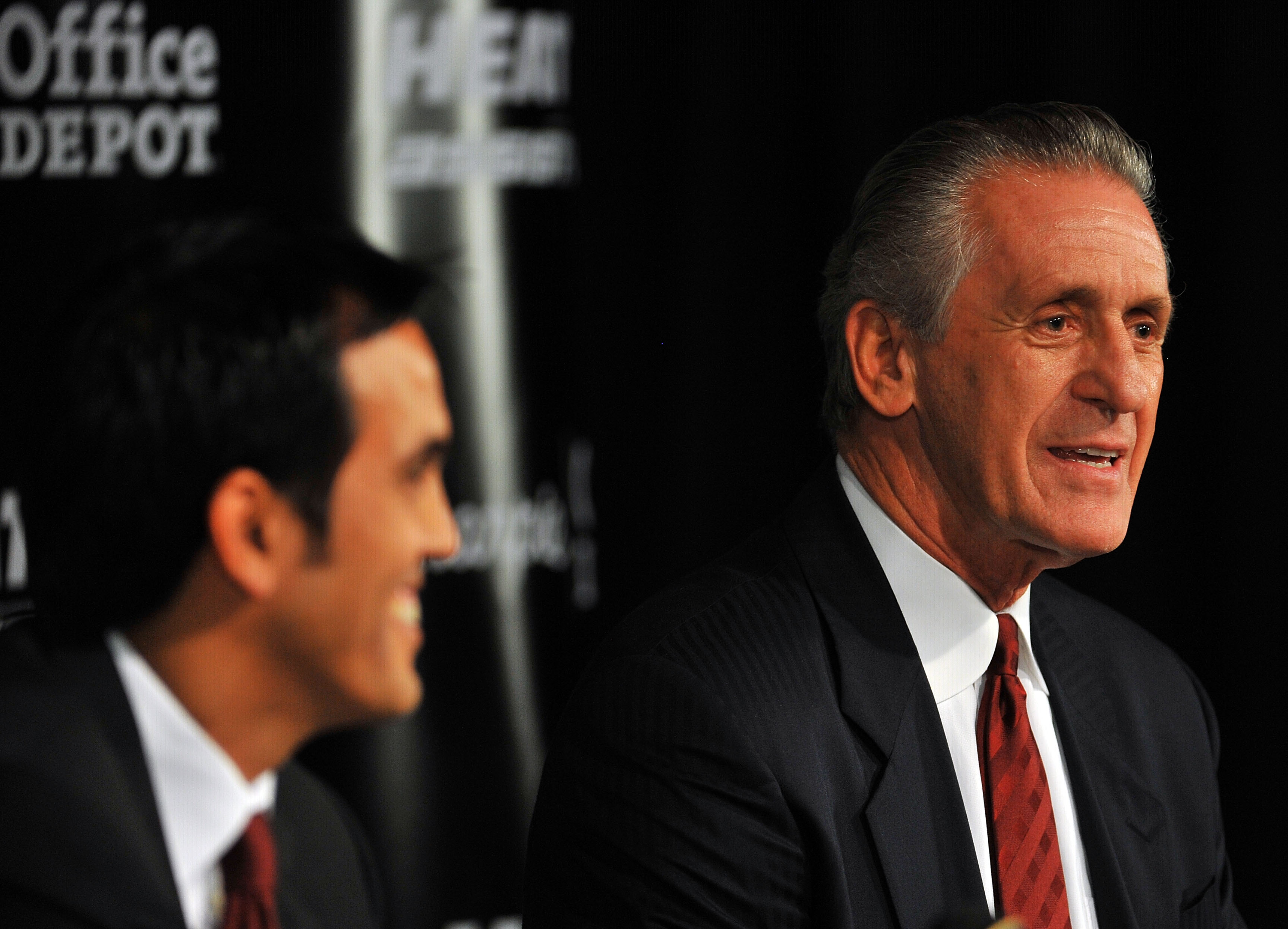 MIAMI - JULY 09:  Head coach Erik Spoelstra (L) and President Pat Riley (R) of the Miami Heat talk during a press conference after a welcome party for new teammates LeBron James, Dwyane Wade, and Chris Bosh at American Airlines Arena on July 9, 2010 in Mi