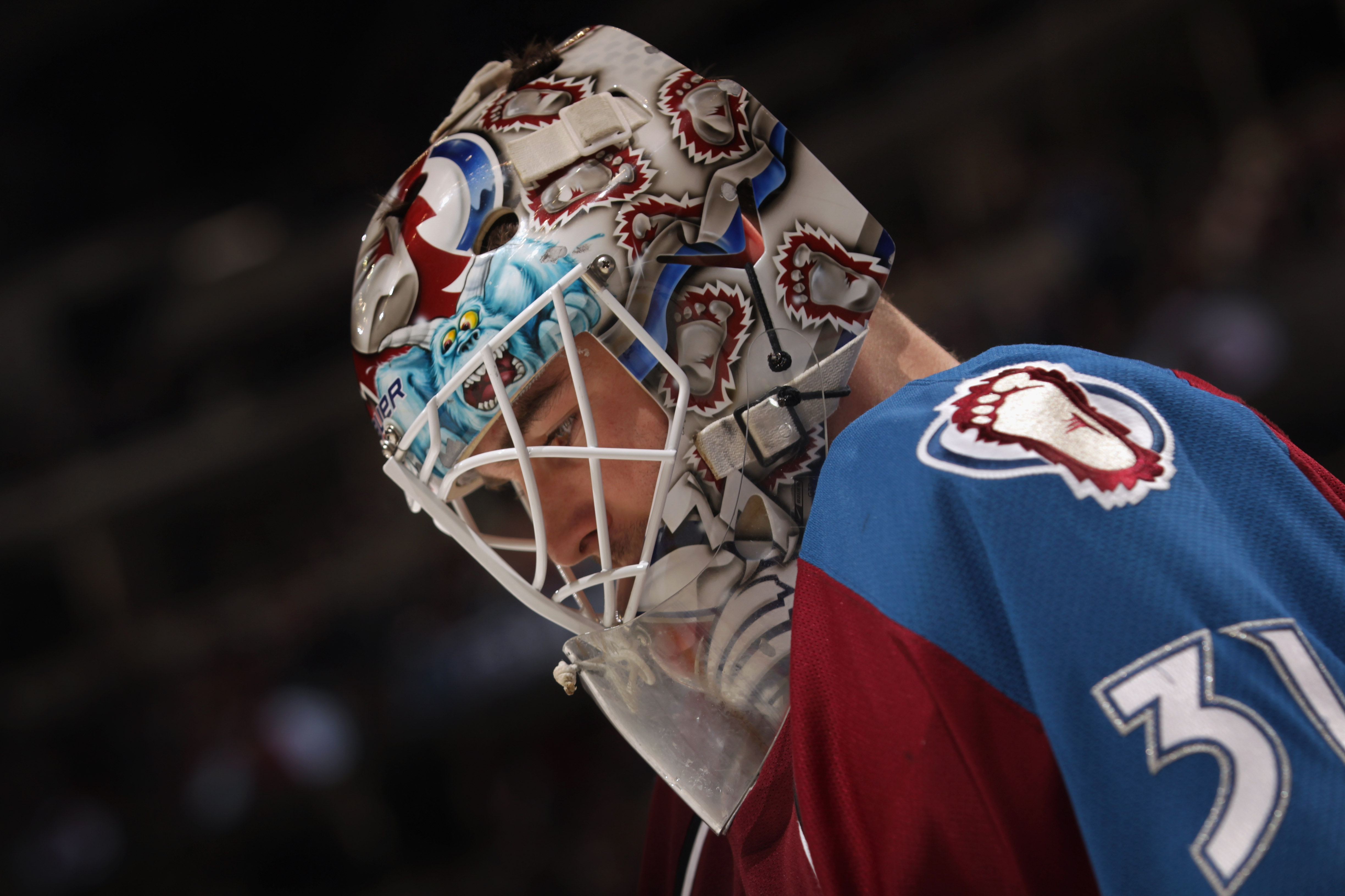 DENVER, CO - FEBRUARY 14:  Goalie Peter Budaj #31 of the Colorado Avalanche looks on during a break in the action after re-entering the game against the Calgary Flames in the second period at the Pepsi Center on February 14, 2011 in Denver, Colorado. The