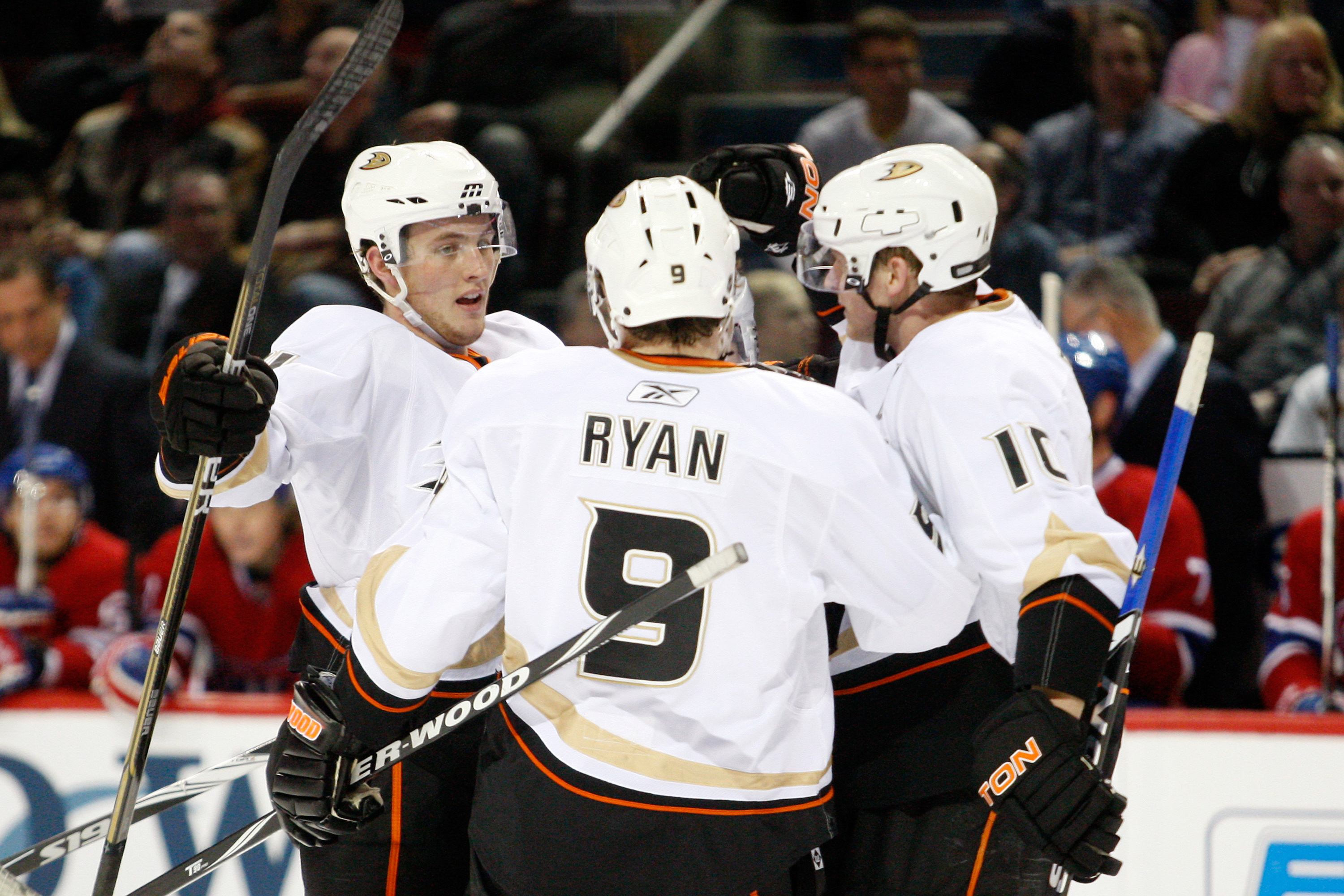 MONTREAL, CANADA - JANUARY 22:  Cam Fowler #4 of the Anaheim Ducks celebrates his first period goal with teammates Bobby Ryan #9 and Corey Perry #10 during the NHL game against the Montreal Canadiens at the Bell Centre on January 22, 2011 in Montreal, Que