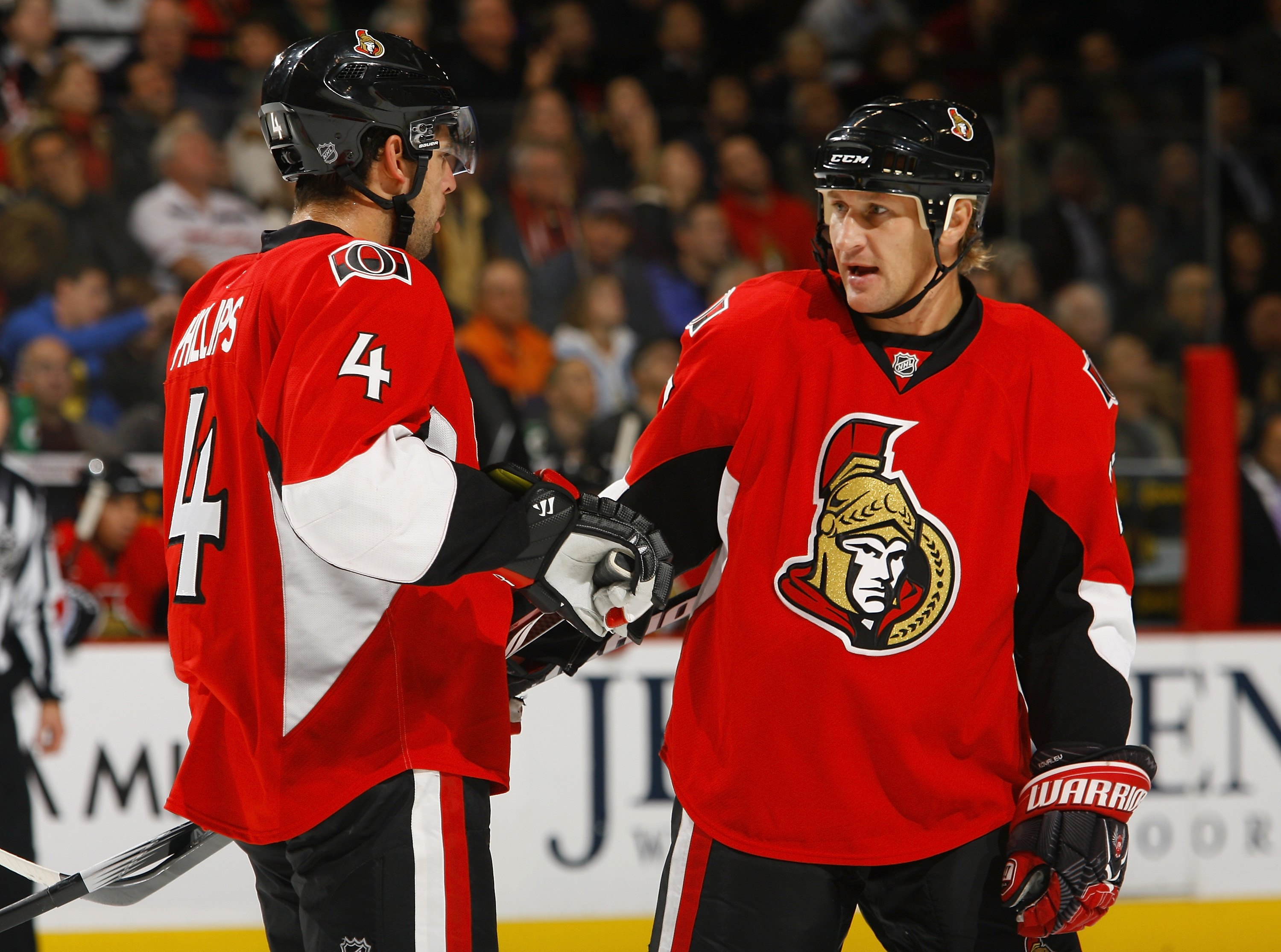OTTAWA, ON - OCTOBER 15:  Chris Phillips#4 Alex Kovalev #27 of the Ottawa Senators talk on the ice against the Tampa Bay Lightning during a game at Scotiabank Place on October 15, 2009 in Ottawa, Canada.  The Ottawa Senators defeated the Tampa Bay Lightni