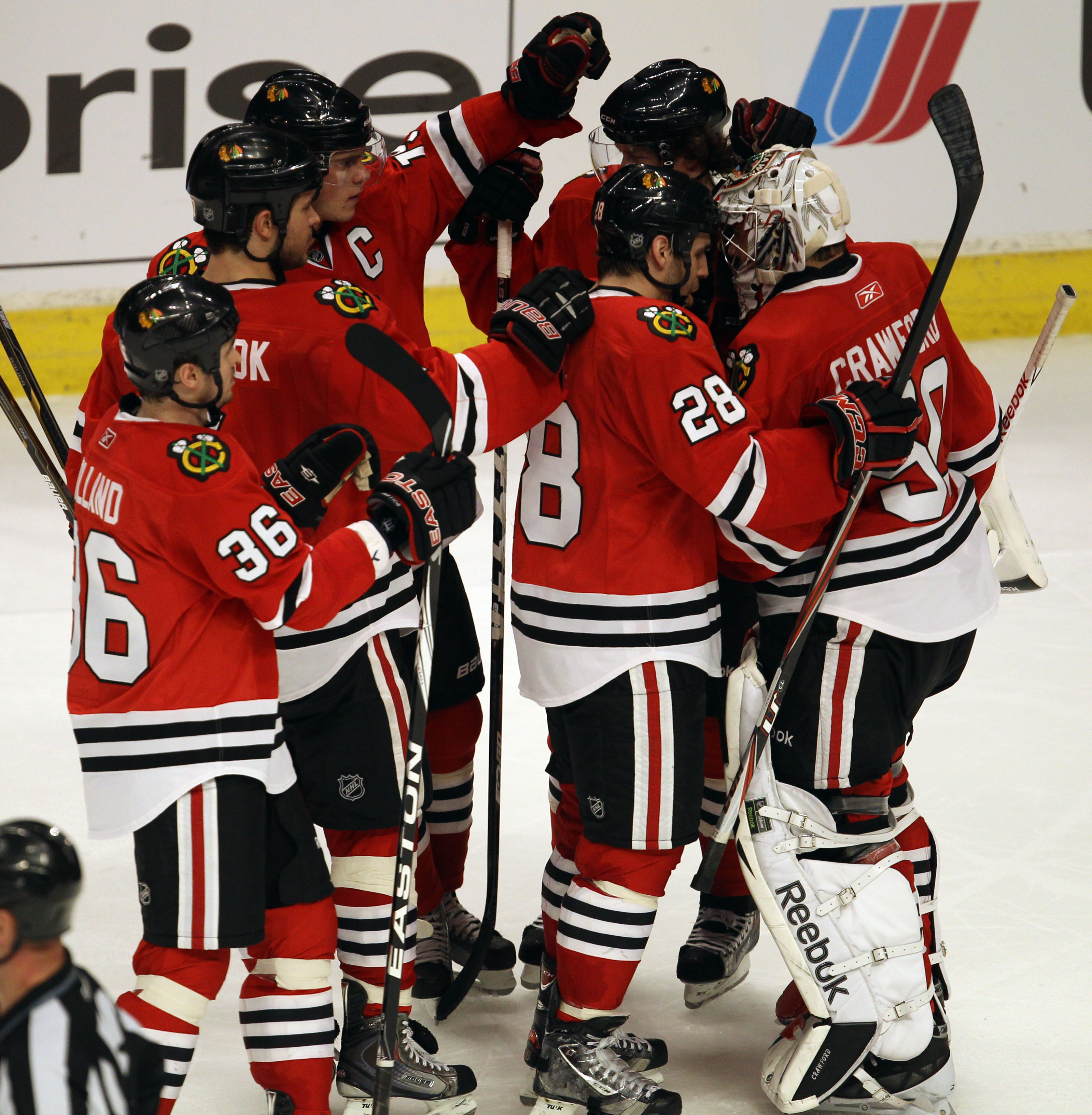 CHICAGO, IL - FEBRUARY 20: Members of the Chicago Blackhawks including Dave Bolland #36, Brent Seabrook #7, Jonathan Toews #19 and Jake Dowell #28 congratulate teammate Corey Crawford #50 after a win over the Pittsburgh Penguins at the United Center on Fe