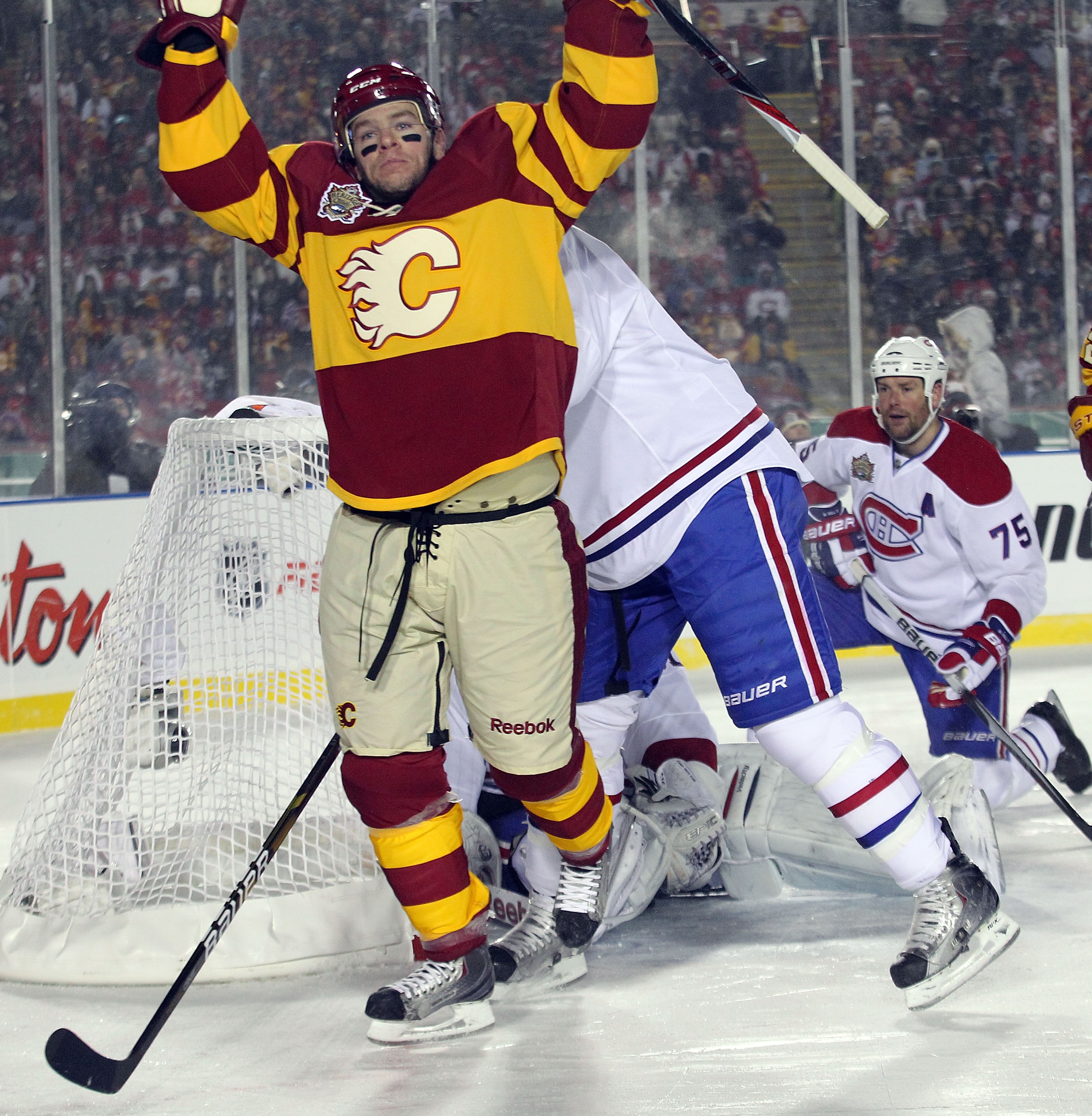 CALGARY, AB - FEBRUARY 20:  Alex Tanguay #40 of the Calgary Flames celebrates his goal at 10:53 of the third period during the 2011 NHL Heritage Classic Game at McMahon Stadium on February 20, 2011 in Calgary, Alberta, Canada. The Flames defeated the Cana