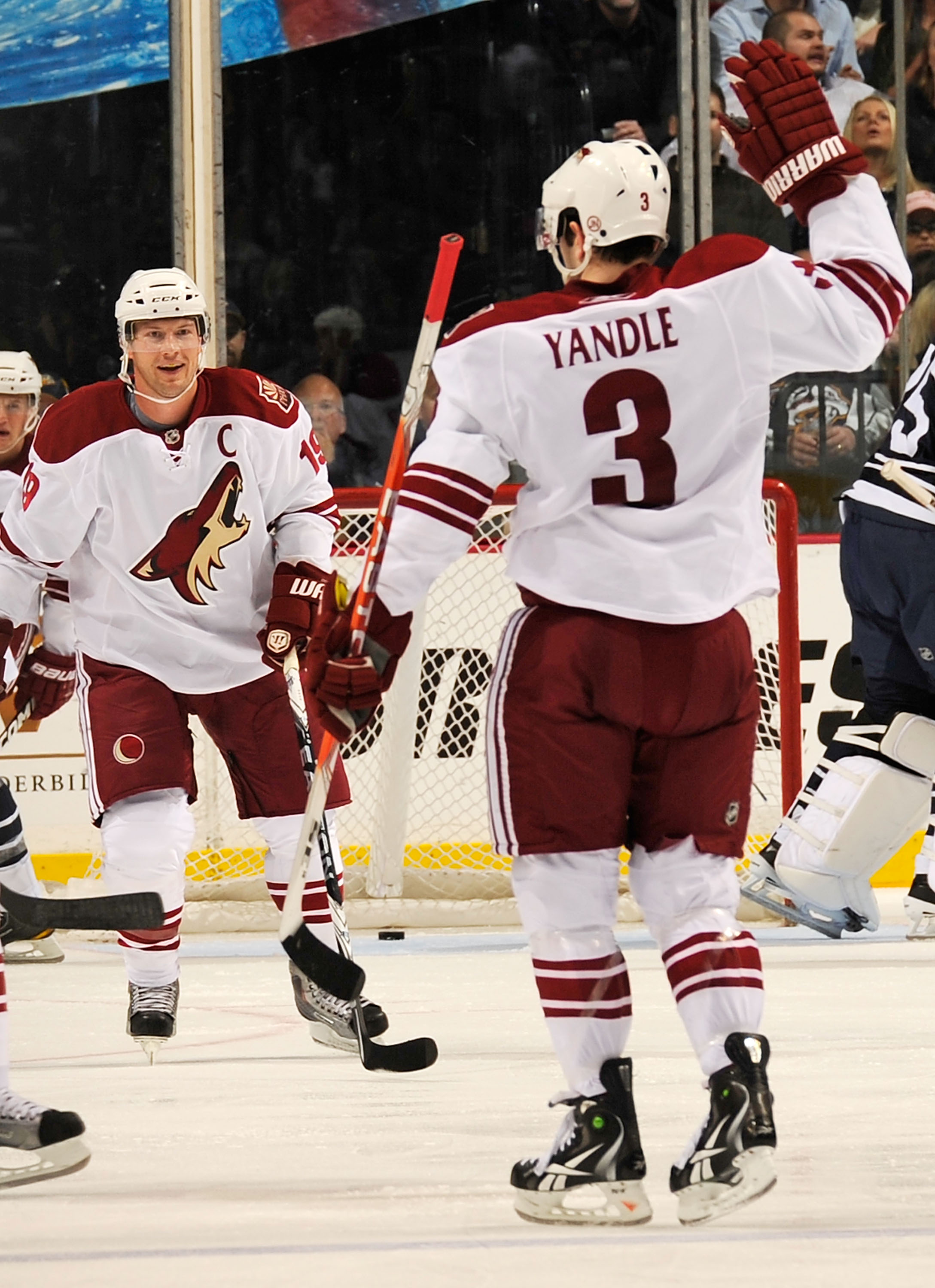 NASHVILLE, TN - FEBRUARY 19:  Shane Doan #19 and Keith Yandle #3 of the Phoenix Coyotes celebrate a goal against the Nashville Predators on February 19, 2011 at the Bridgestone Arena in Nashville, Tennessee.  (Photo by Frederick Breedon/Getty Images)