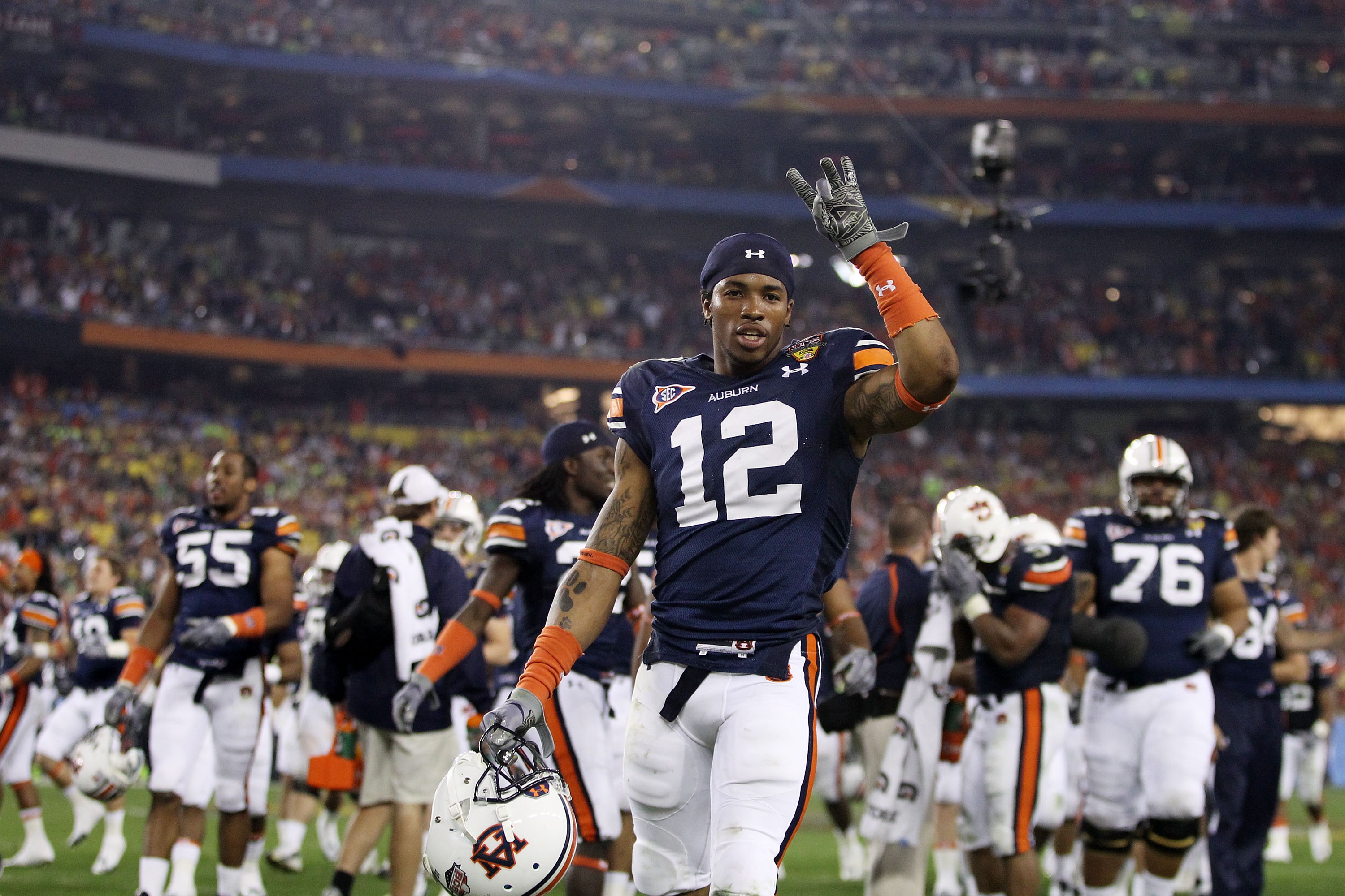 GLENDALE, AZ - JANUARY 10:  Demetruce McNeal #12 of the Auburn Tigers gestures against the Auburn Tigers the Tostitos BCS National Championship Game against the Oregon Ducks at University of Phoenix Stadium on January 10, 2011 in Glendale, Arizona.  (Phot