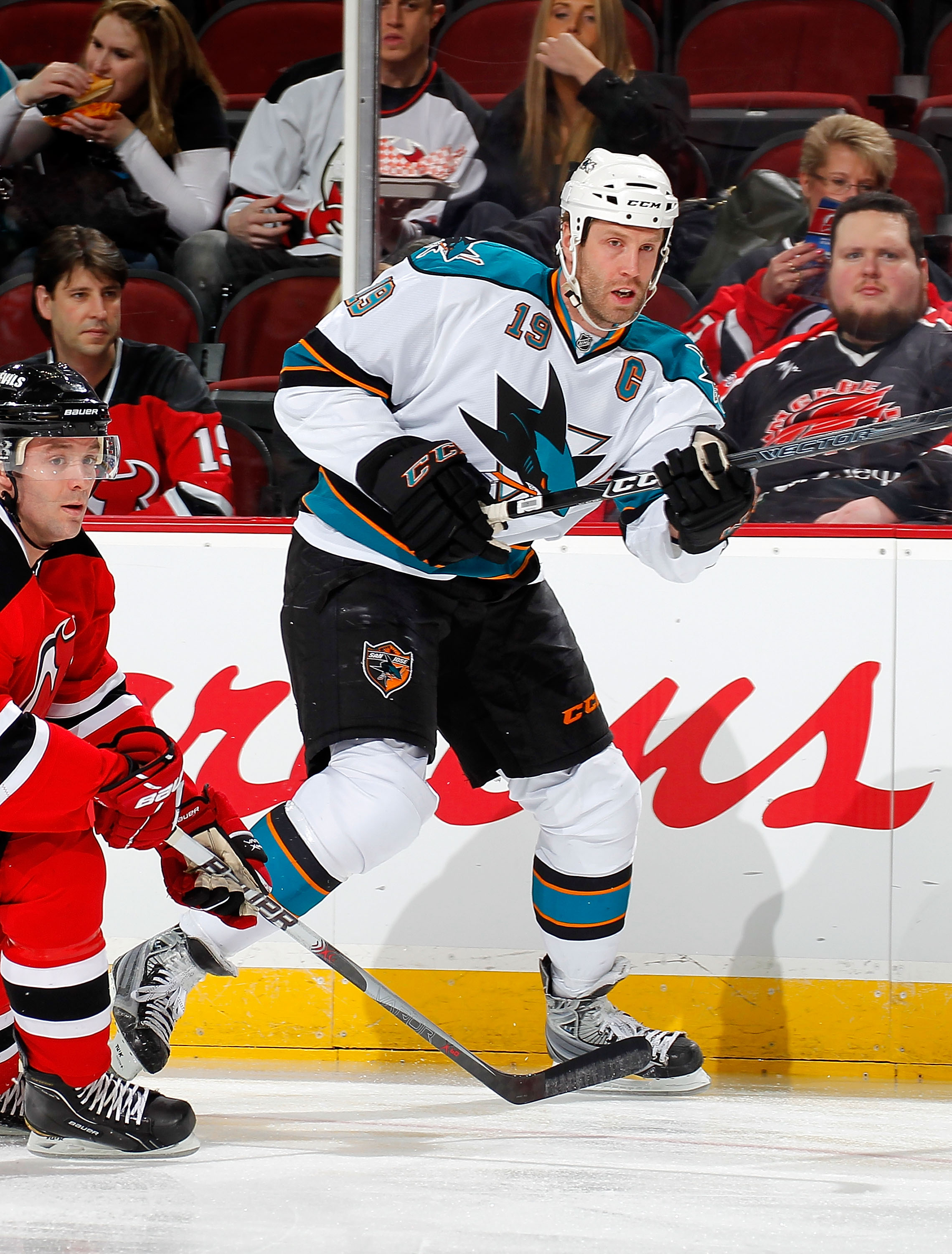 NEWARK, NJ - FEBRUARY 11: Joe Thornton #19 of the San Jose Sharks passes in an NHL hockey game against the New Jersey Devils on February 11, 2011 at the Prudential Center in Newark, New Jersey. (Photo by Paul Bereswill/Getty Images)